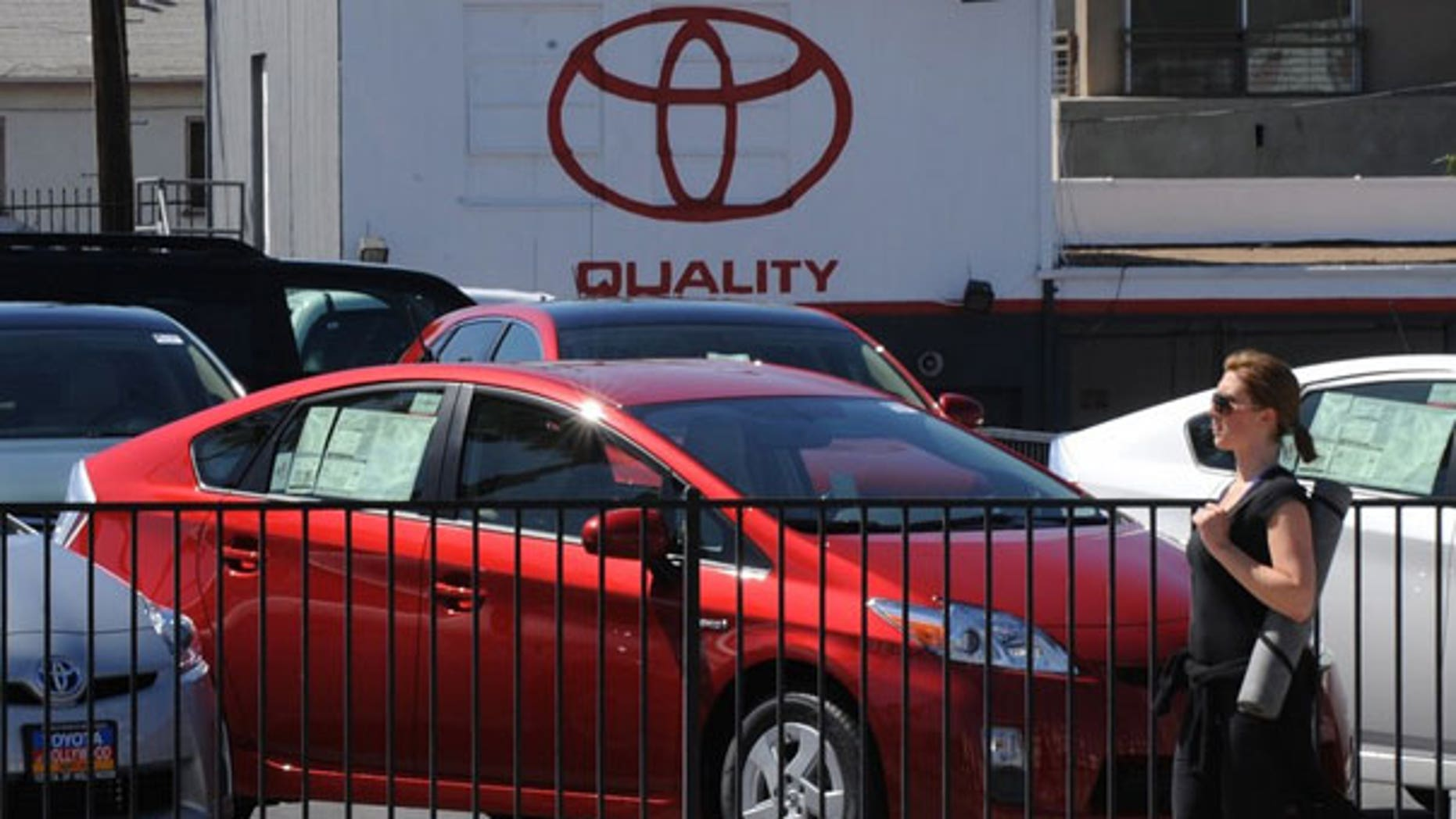 April 6: A woman walks past Toyota Prius cars for sale at a Toyota dealer in Hollywood. (AFP)