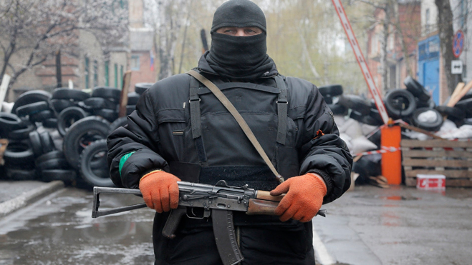 April 13, 2014: A pro-Russian gunman stands guard at a seized police station in the eastern Ukraine town of Slovyansk.