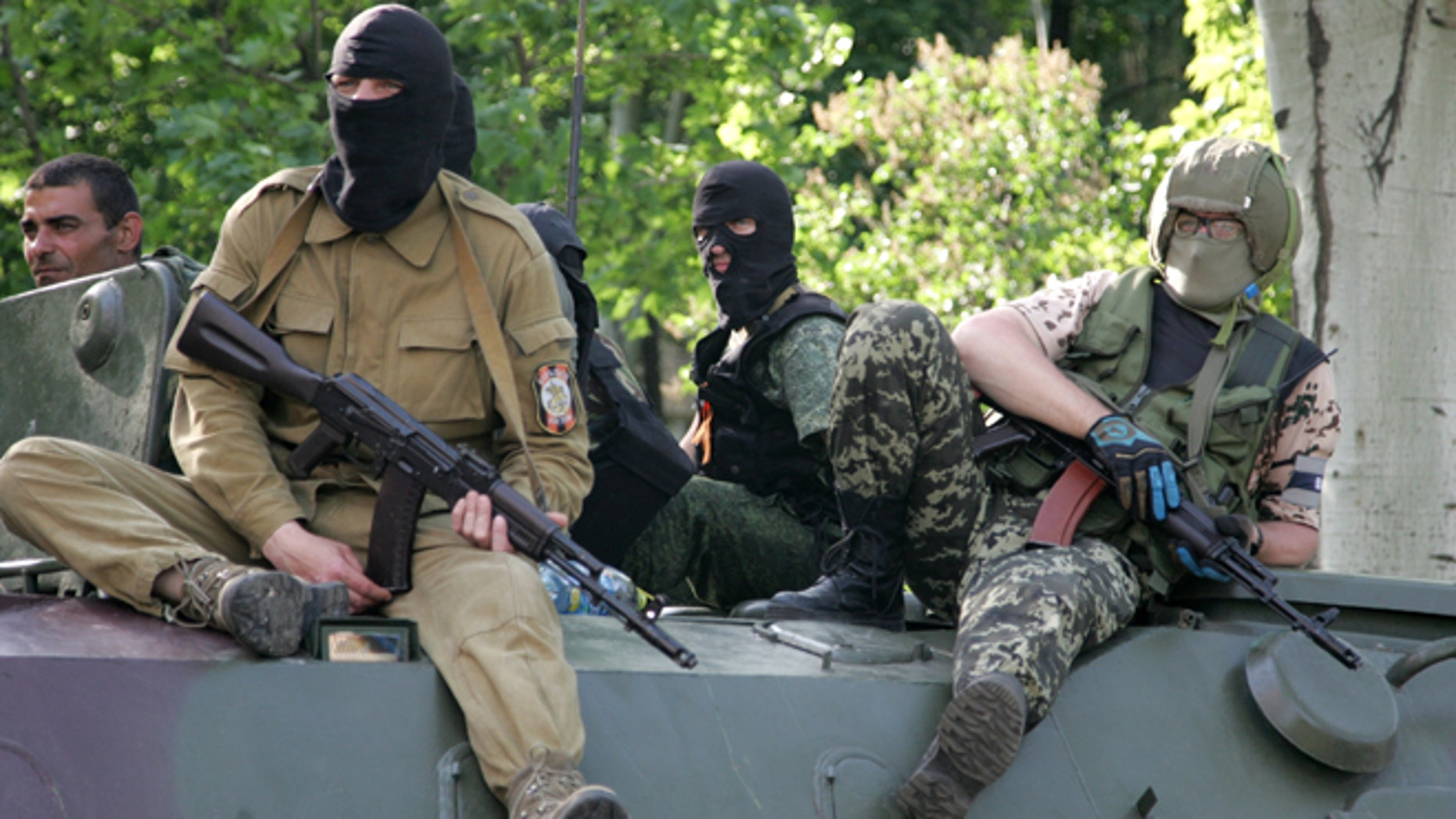 May 20, 2014: Pro-Russian gunmen atop of an armored personnel carrier patrol a street in Donetsk, Ukraine. One rebel leader in Donetsk, Denis Pushilin, retaliated Tuesday by threatening to nationalize Akhmetovs assets over his refusal to pay taxes to the Donetsk Peoples Republic.