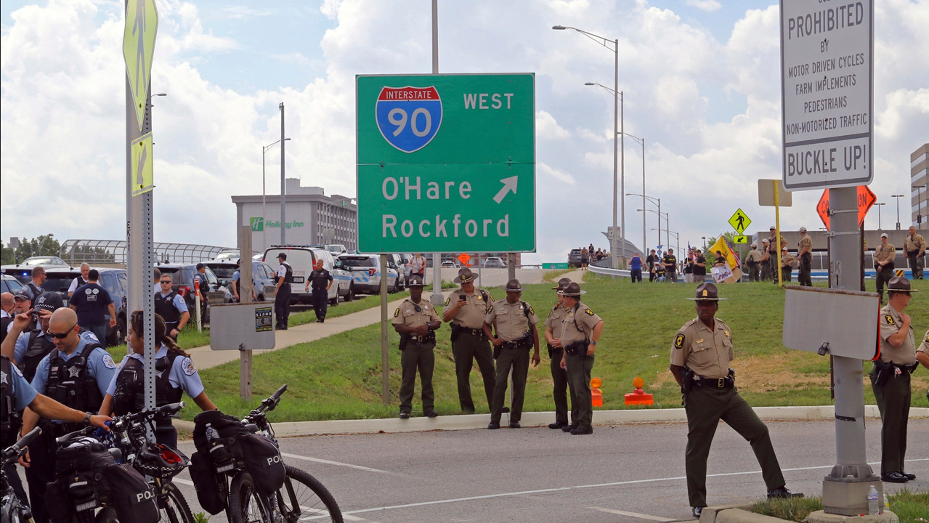 Police watch along a ramp leading onto the Kennedy Expressway in Chicago, Monday, Sept. 3, 2018, after demonstrators had planned to march westbound on Interstate 90 for about a mile.