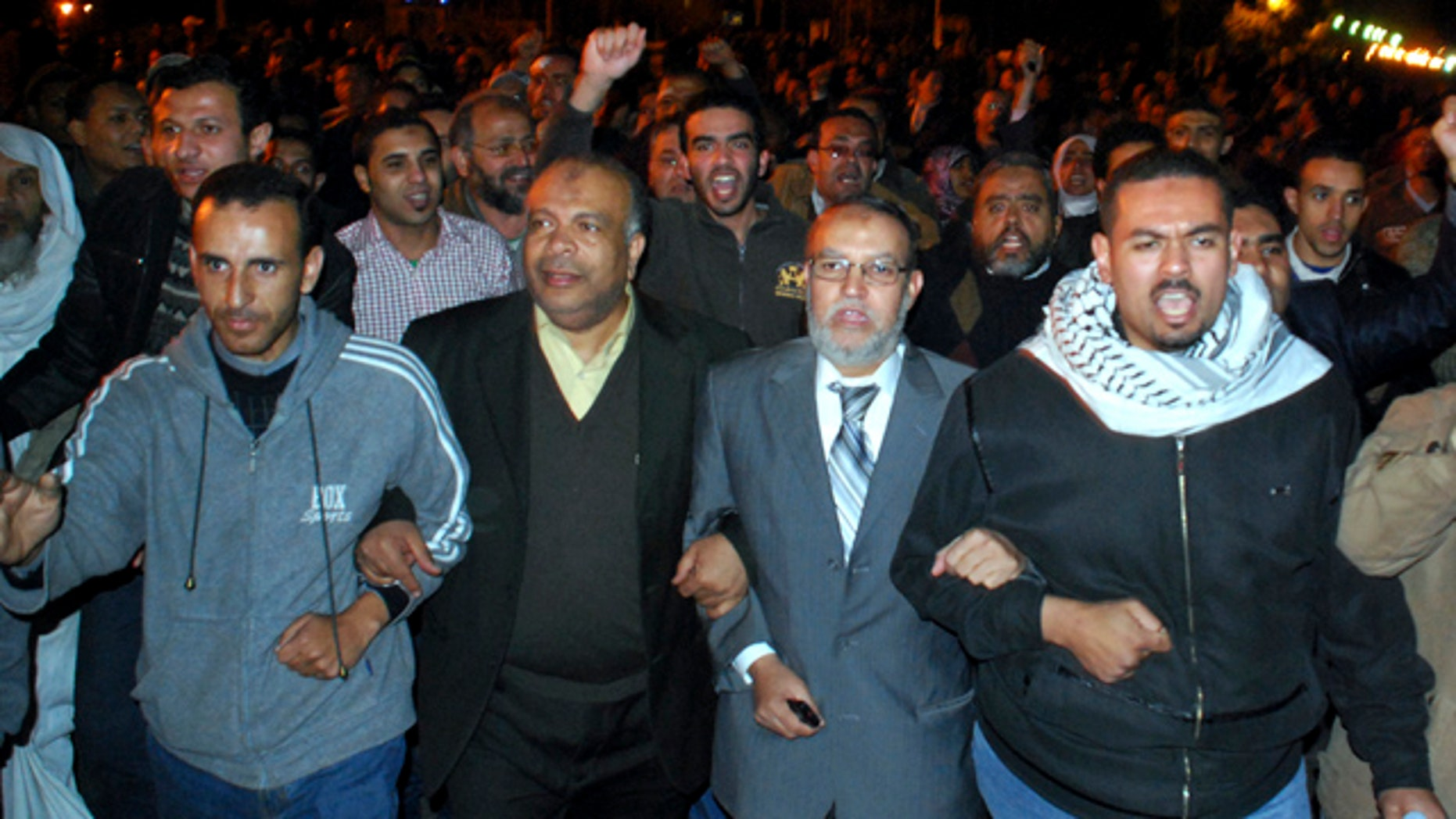 Jan. 30, 2011: Egyptian Brotherhood seniors Essam el-Erian, centre right, and Saad el-Katatni, centre left, take part in a protest in Cairo, Egypt.