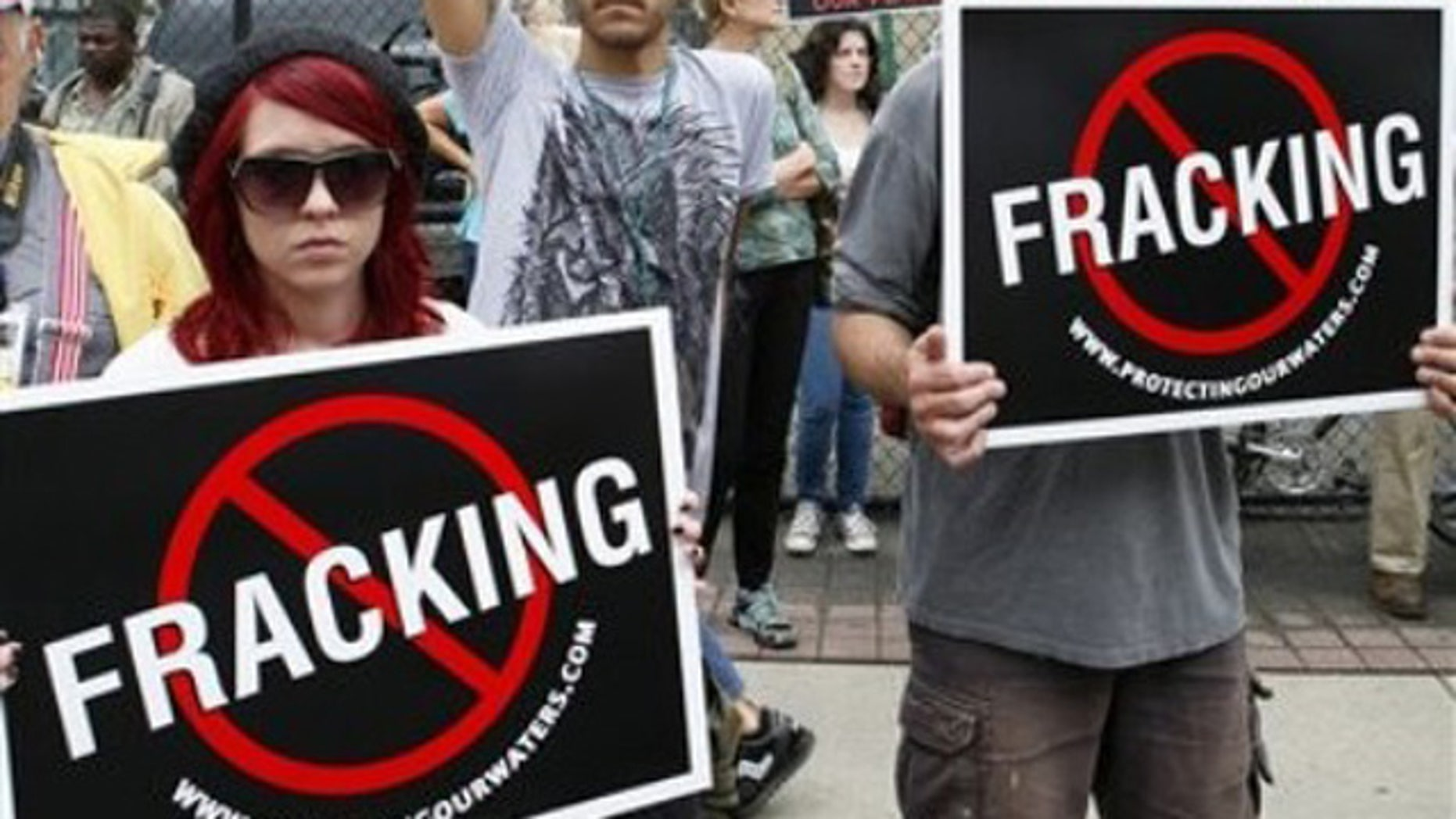 Sept. 7, 2011: Protesters in Philadelphia hold up signs protesting against hydraulic gas drilling, or 'fracking,' outside the Philadelphia convention center.