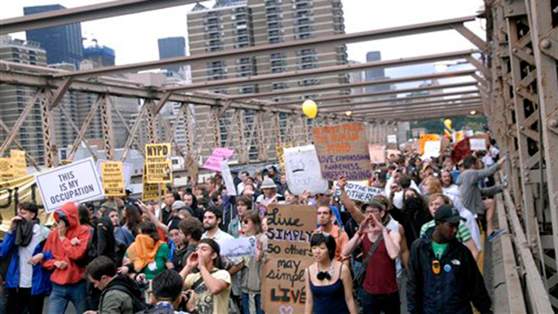 In this Oct. 1 photo, protesters walk onto New York's Brooklyn Bridge before police begin making arrests.
