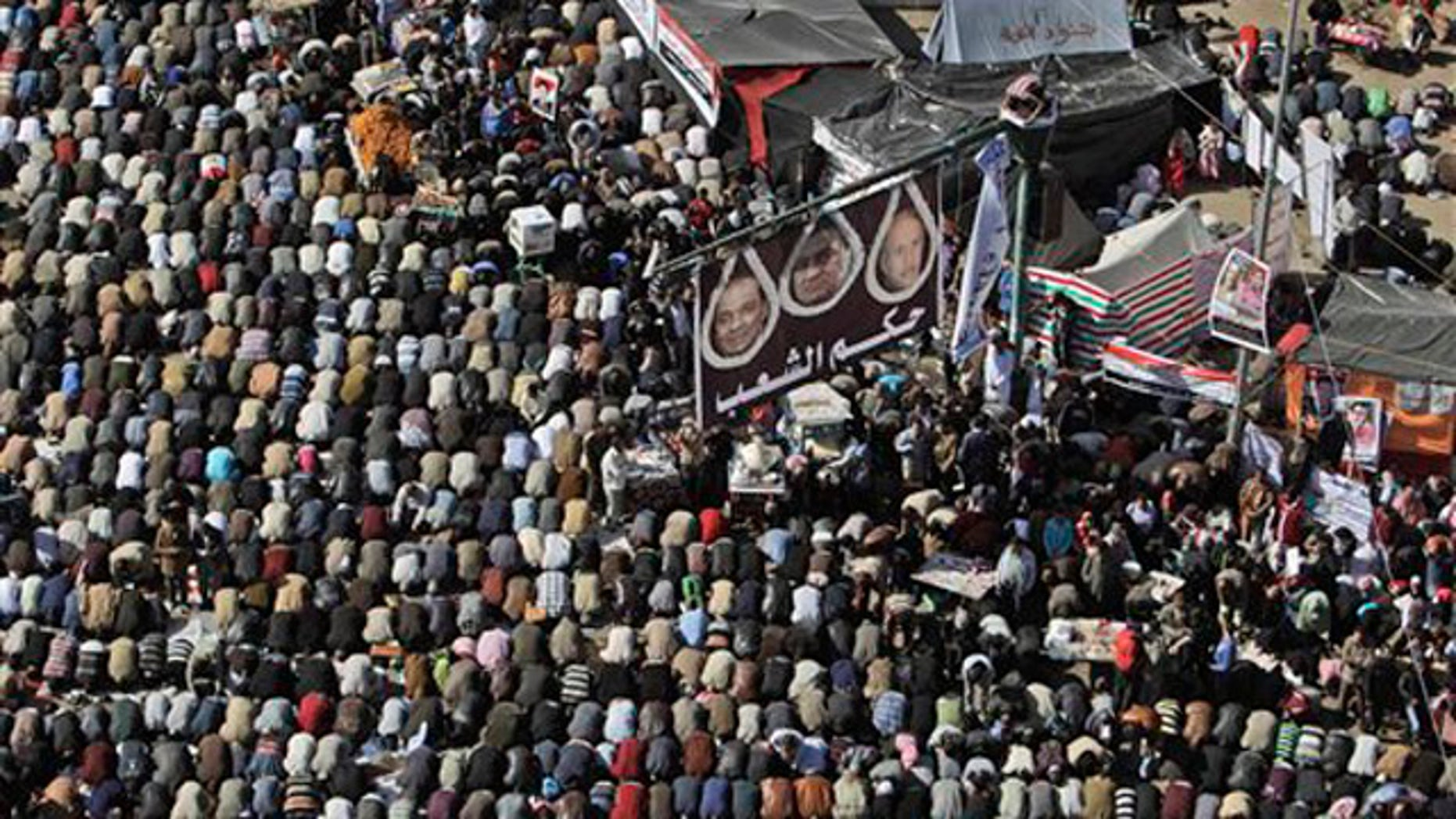 Jan. 27, 2012: Egyptian protesters attend Friday prayers during a rally to mark the first anniversary of the 'Friday of Rage' in Tahrir Square, in Cairo, Egypt.