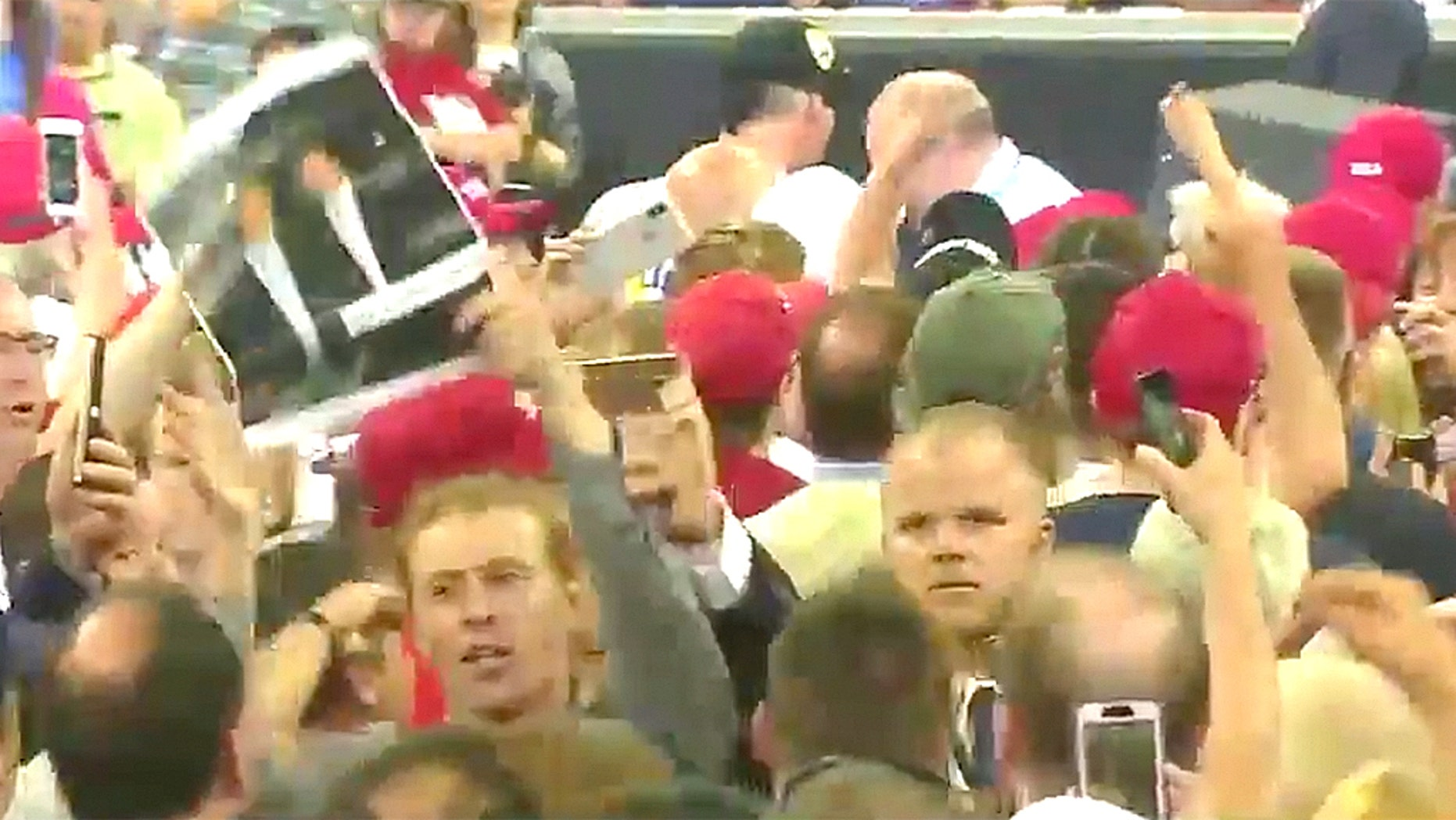 Sam Spadino was booted from Duluth's Amsoil Arena for allegedly yelling at Trump and calling him a rapist before security removed him.