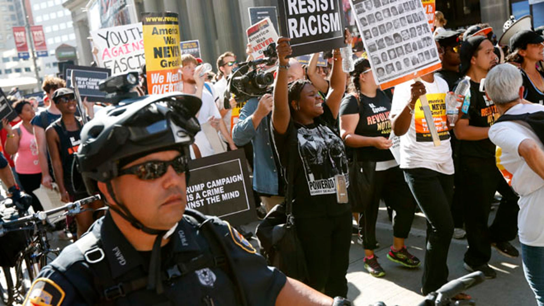 Protesters march in downtown Cleveland, on Tuesday, July 19, 2016, during the second day of the Republican convention. (AP Photo/John Minchillo)