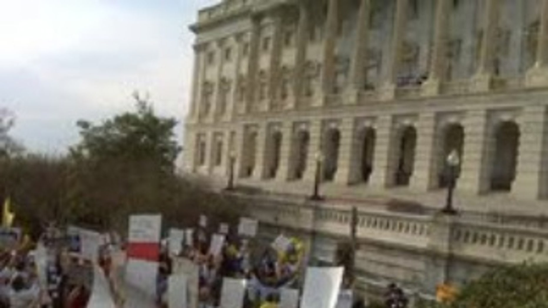 Pro-Health Care Reform and Anti-Health Care Reform Protestors Rally in front of the Capitol