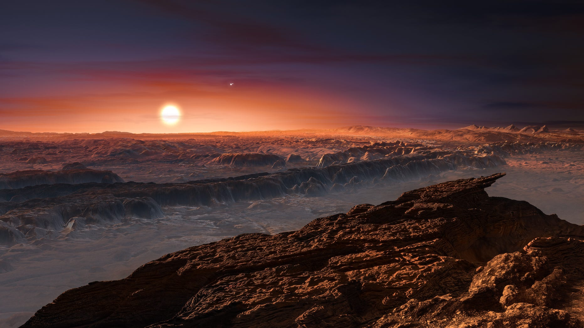 An artist's impression shows a view of the surface of the planet Proxima b orbiting the red dwarf star Proxima Centauri, the closest star to the Solar System.
