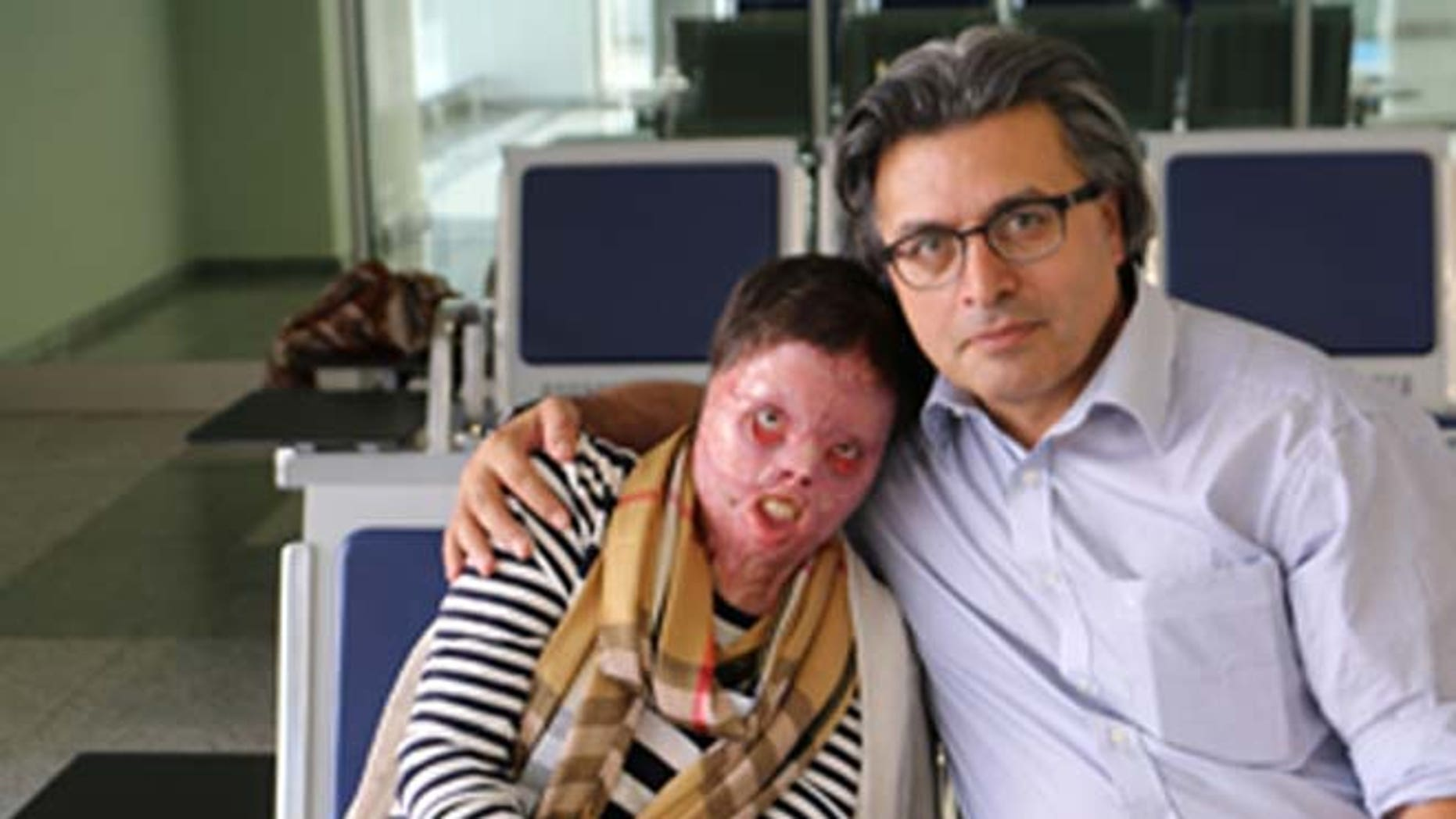Yasmin, who set herself on fire to avoid a brutal attack by ISIS, is shown with Dr. Jan Kizihan.
