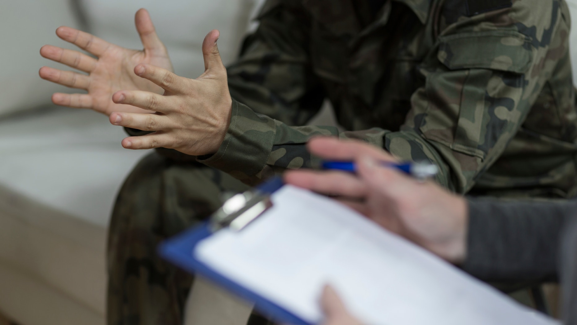 Soldier sitting on the sofa during psychological therapy