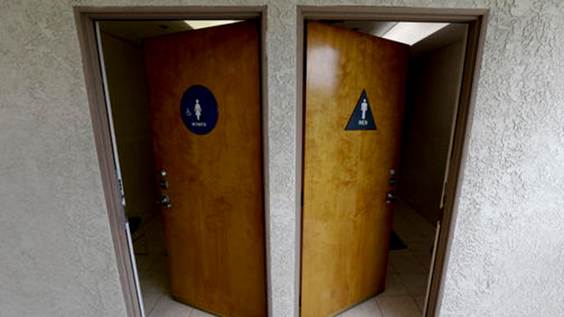 The doors to public restrooms are propped open at a office complex on Monday, May 9, 2016 in Anaheim, Calif.