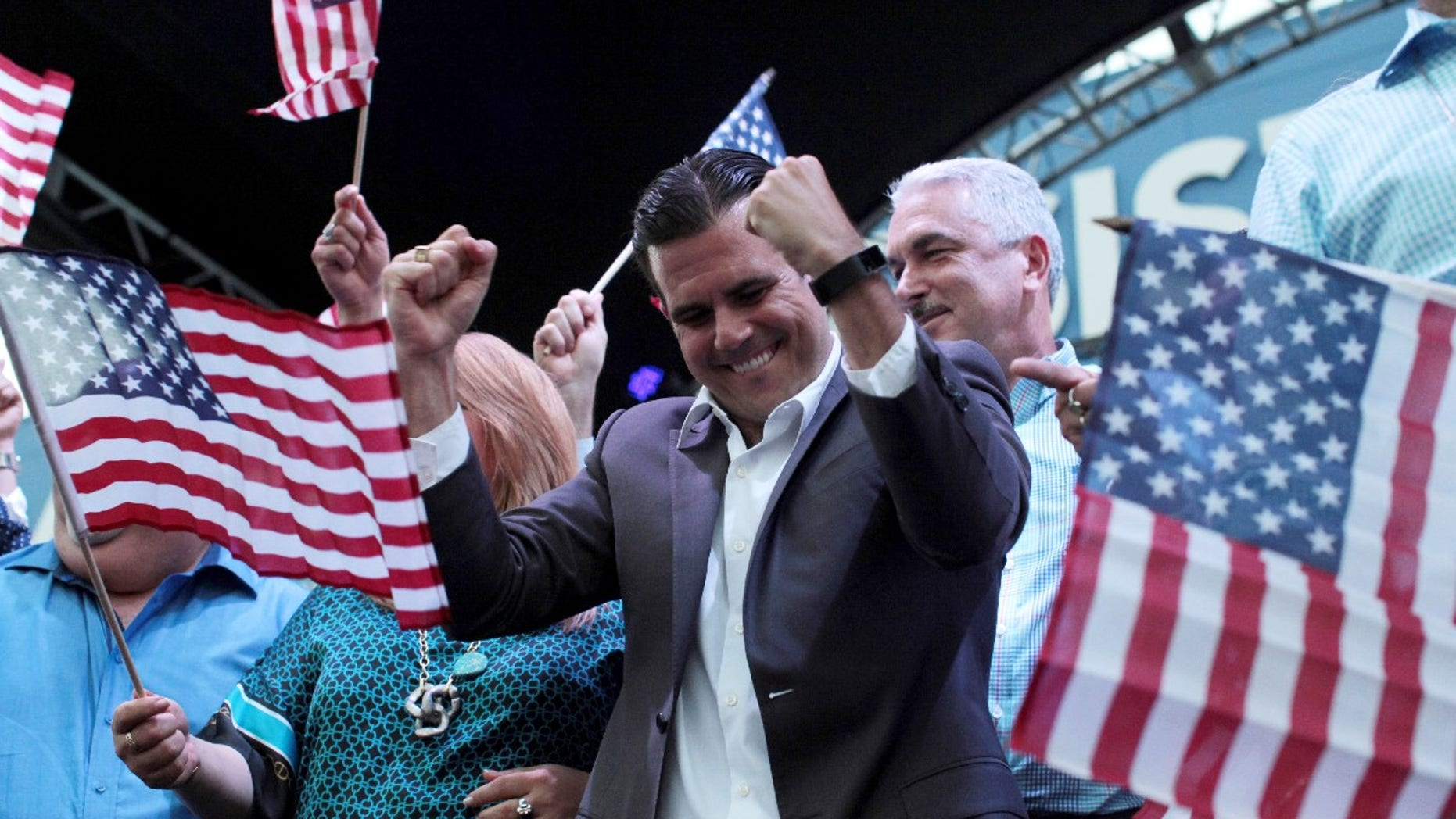 FILE -- Puerto Rico Governor Ricardo Rosello (C) celebrates after the economically struggling U.S. island territory voted overwhelmingly on Sunday in favour of becoming the 51st state, in San Juan, Puerto Rico June 11, 2017.
