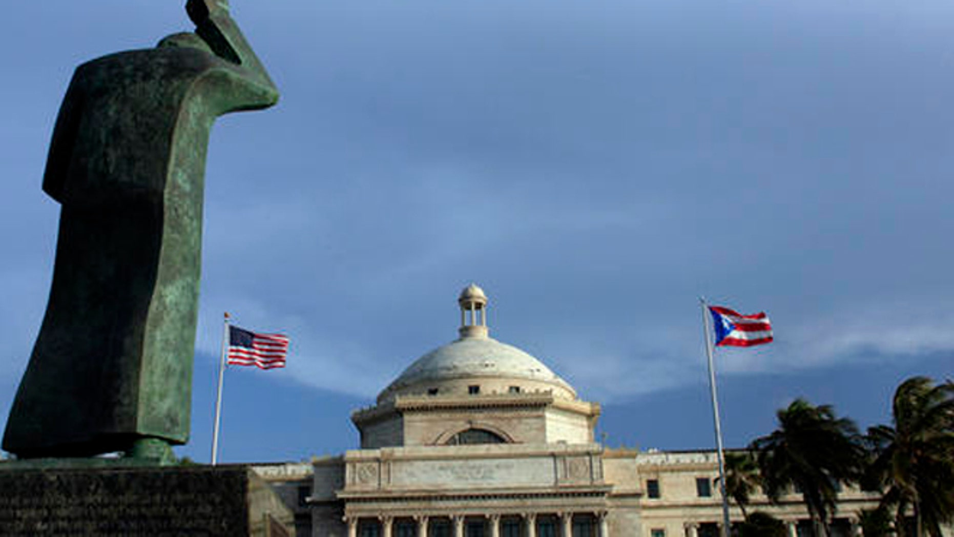 A bronze statue of San Juan Bautista stands in front of Puerto Rico's capitol in San Juan.