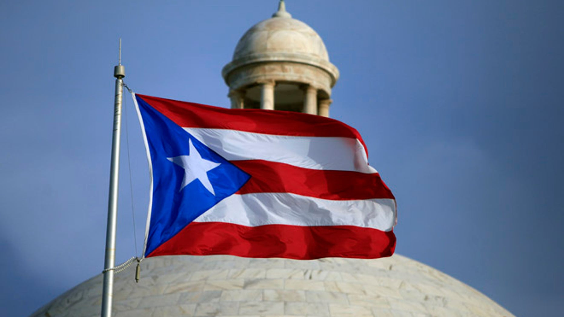 In this July 29, 2015 file photo, the Puerto Rican flag flies in San Juan.