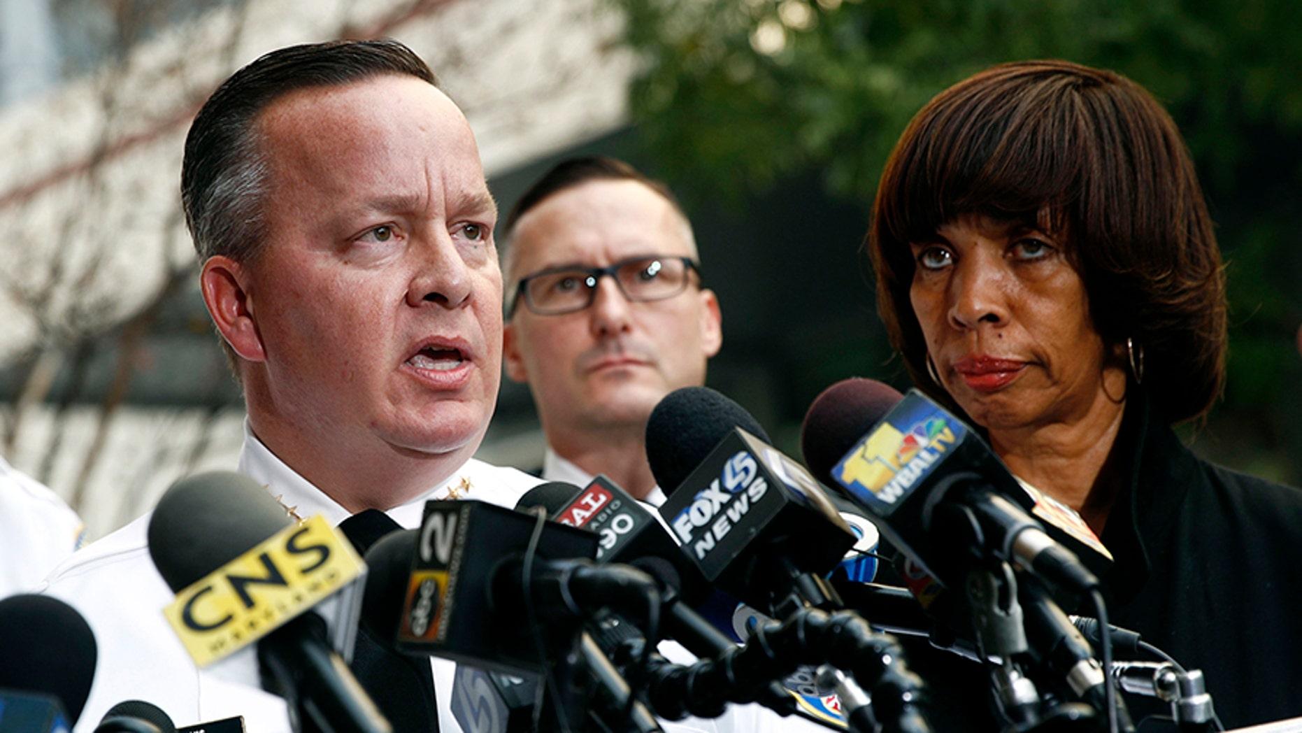Baltimore Police Department Commissioner Kevin Davis, left, speaks alongside Mayor Catherine Pugh at a news conference last November.
