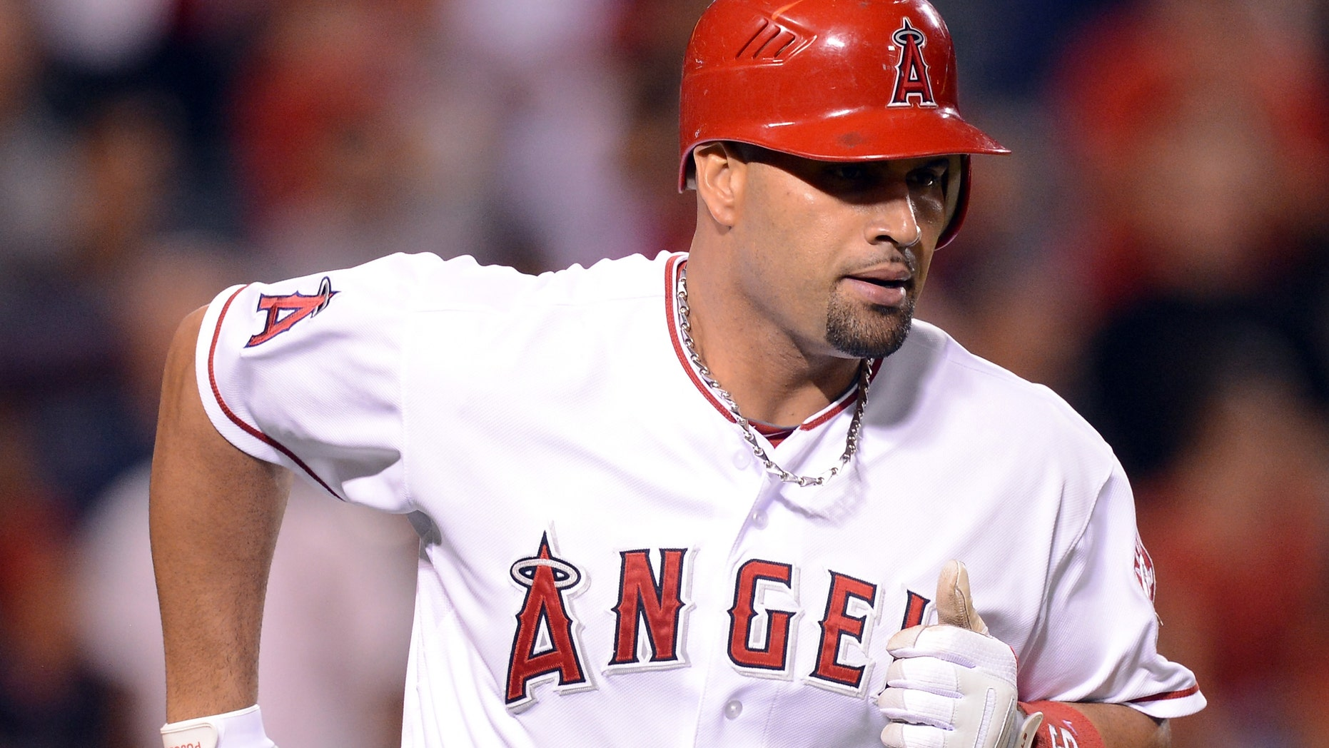 ANAHEIM, CA - SEPTEMBER 12:  Albert Pujols #5 of the Los Angeles Angels reacts to his homerun to become the first player to hit at least 30 homeruns in each of his first 12 seasons during the ninth inning against the Oakland Athletics at Angel Stadium of Anaheim on September 12, 2012 in Anaheim, California.  (Photo by Harry How/Getty Images)