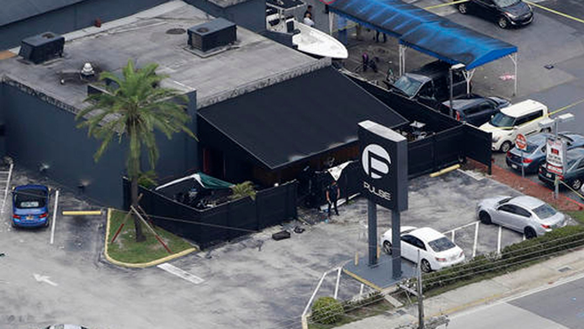 Law enforcement officials work at the Pulse gay nightclub in Orlando, Fla., in June following the mass shooting. (AP)