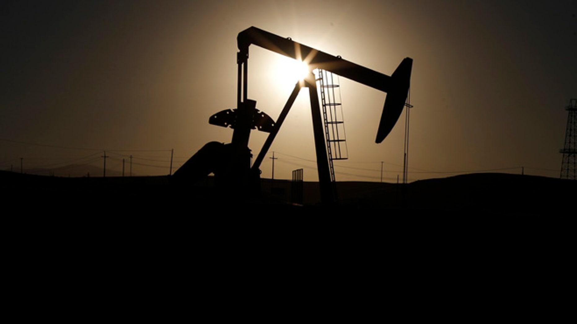 Oct. 14, 2014: A pump jack is seen at sunrise near Bakersfield, California. (Reuters)