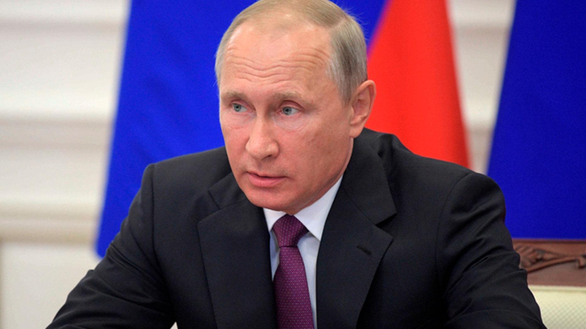 Russian President Vladimir Putin chairs a meeting on the development of transport infrastructure in Kaliningrad, Russia, Wednesday, Aug. 16, 2017. (Alexei Druzhinin, Sputnik/Kremlin Pool Photo via AP)