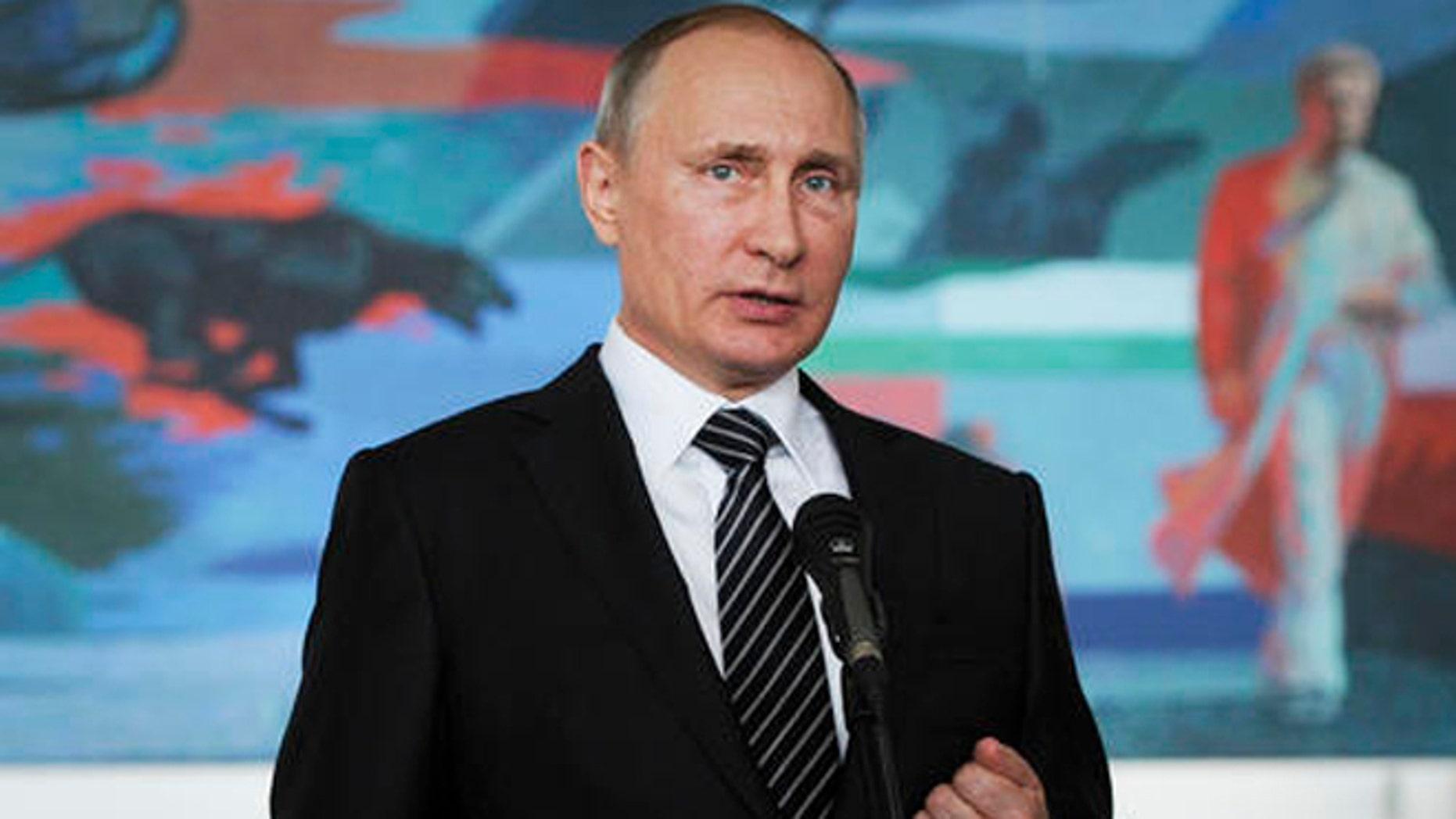 Russian President Vladimir Putin gestures while speaking during a news conference in Bishkek, Kyrgyzstan, Saturday. (Mikhail Klimentyev/Sputnik, Kremlin Pool Photo via AP)