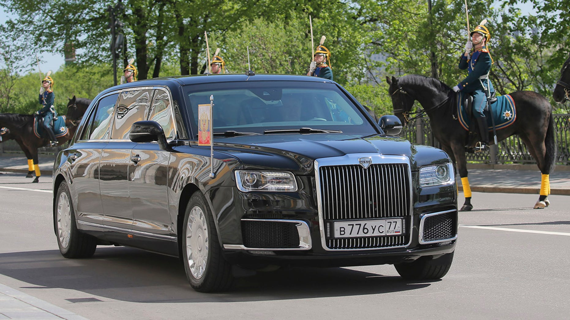 One of Russia's new Presidential limousine is driven during the inauguration ceremony of Vladimir Putin, in Moscow, Russia, Monday, May 7, 2018. Putin took the oath of office for his fourth term as Russian president on Monday and promised to pursue an economic agenda that would boost living standards across the country. (Sergei Savostyanov, Sputnik, Kremlin Pool Photo via AP)