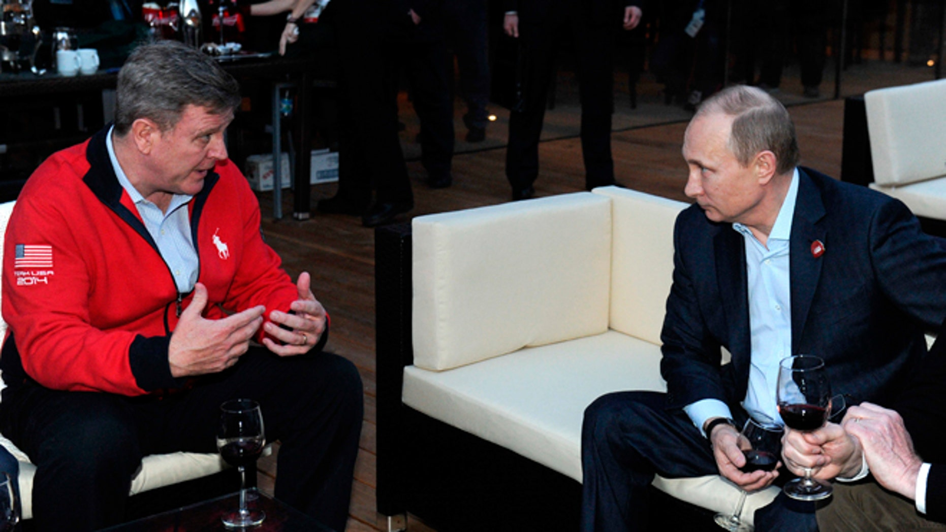 Feb. 14, 2014 : Russian President Vladimir Putin, right, speaks with Head of the United States National Olympic Committee Scott Blackmun while visiting USA House during the 2014 Winter Olympics in Sochi, Russia.