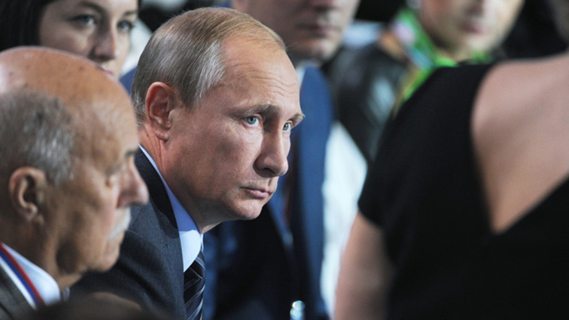 Sept. 7, 2015: Russian President Vladimir Putin, center, listens to a question during a meeting with his supporters in Moscow, Russia.