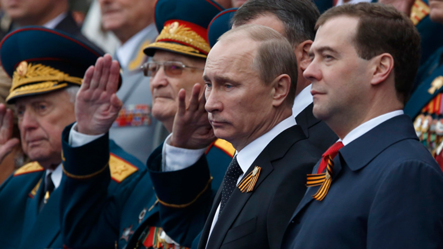 May 9, 2012: Russian President Vladimir Putin, second right, and Prime Minister Dmitry Medvedev, right, watch the Victory Day Parade, which commemorates the 1945 defeat of Nazi Germany on the Red Square in Moscow,  Russia.