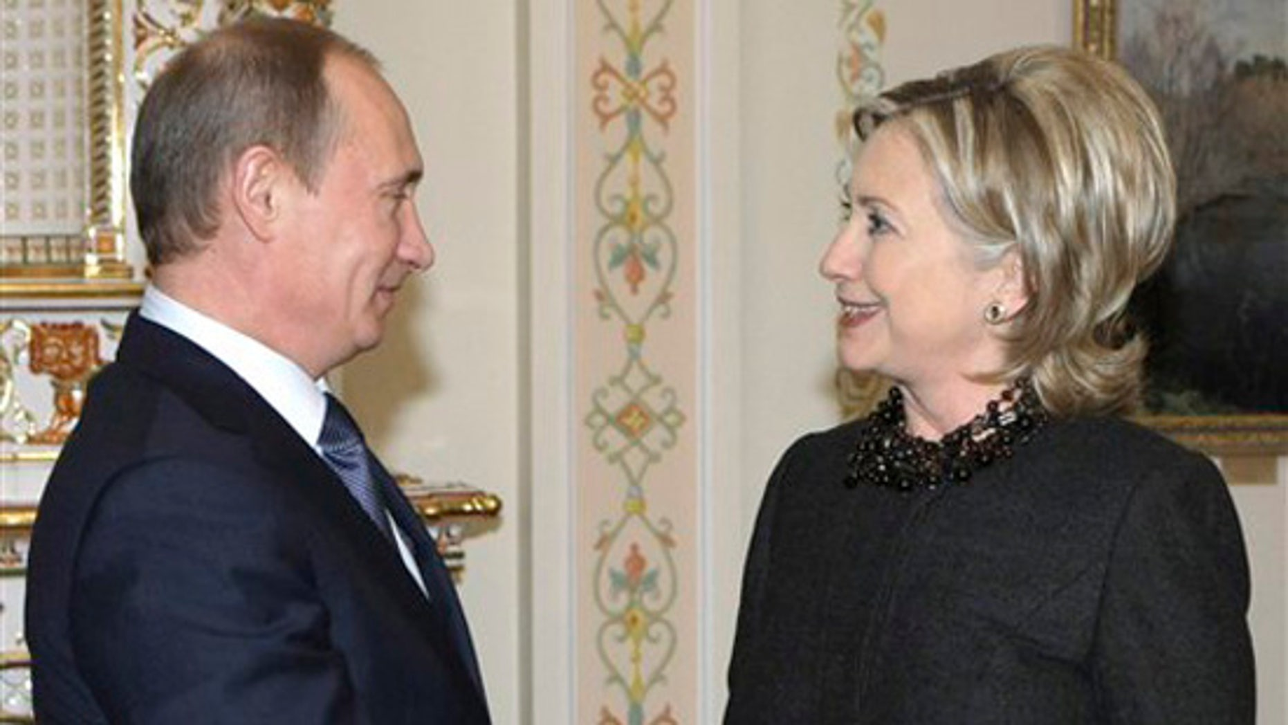 Russian Prime Minister Vladimir Putin, left, greets U.S. Secretary of State Hillary Rodham Clinton during a meeting at the Novo-Ogaryovo just outside Moscow, Friday, March 19, 2010. (AP)