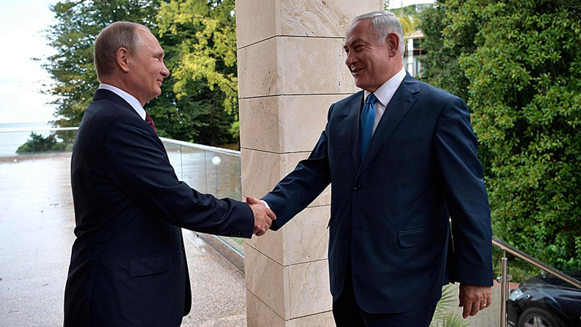 Russian President Vladimir Putin, left, welcomes Israeli Prime Minister Benjamin Netanyahu.