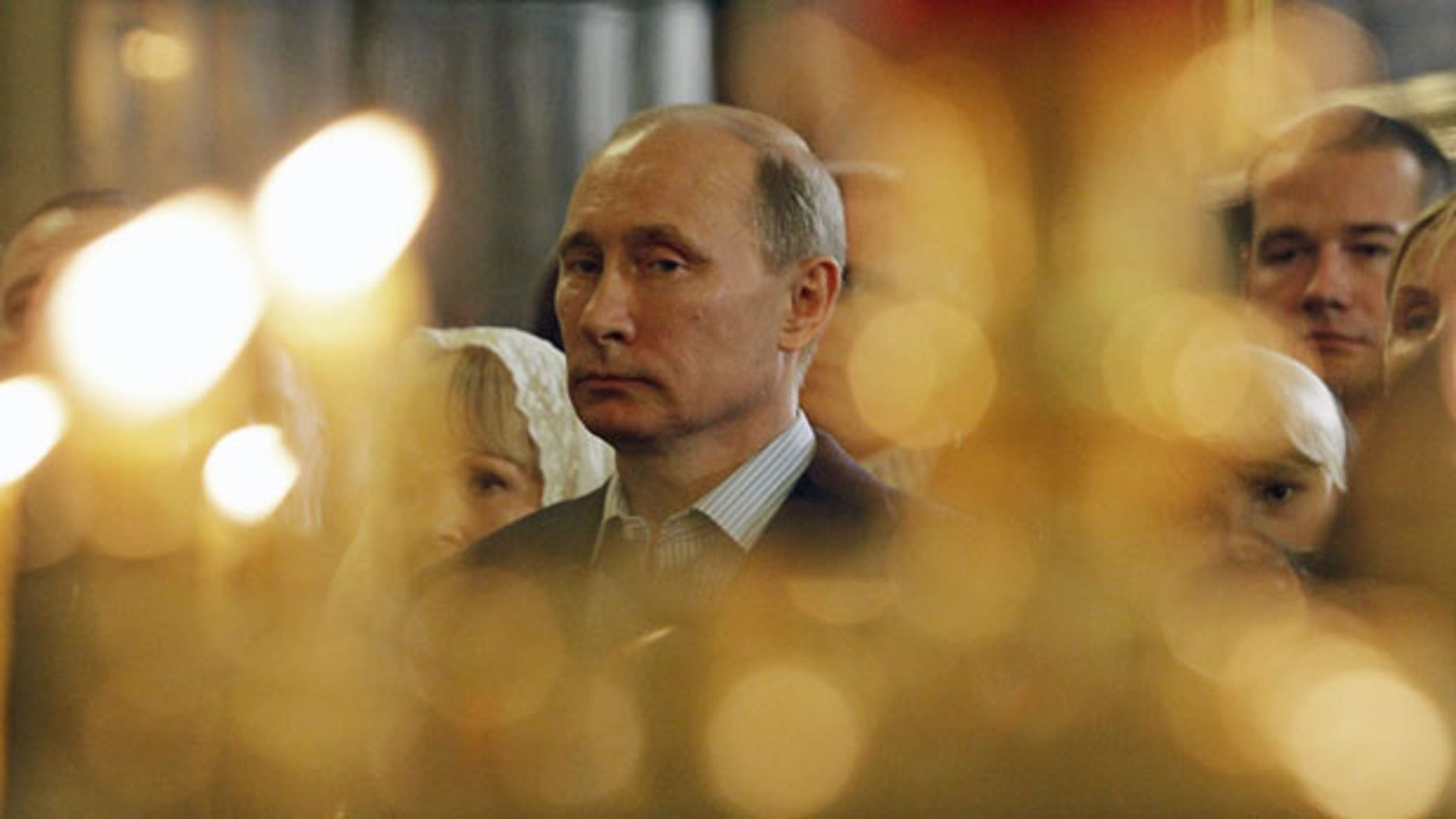 Vladimir Putin attends a Russian Orthodox Christmas service in 2012. (AP)