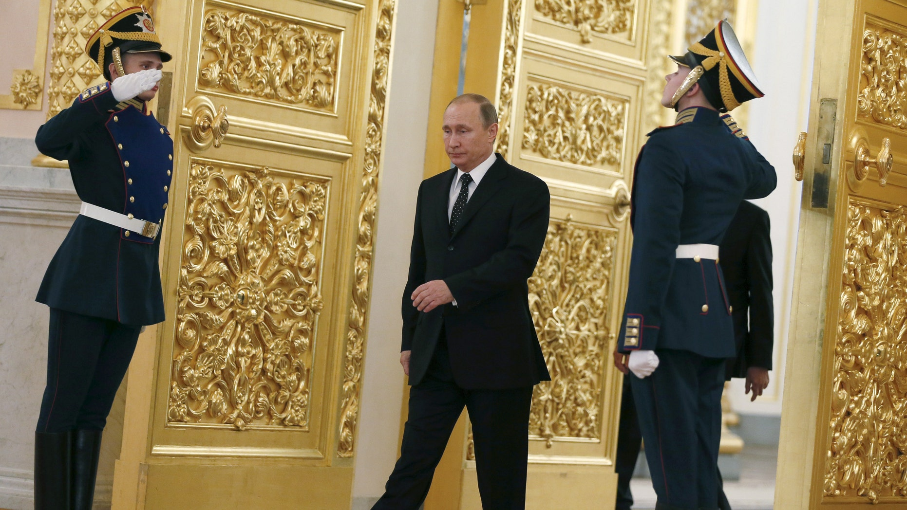Russia's President Vladimir Putin walks past honor guards as he attends a ceremony to receive diplomatic credentials from foreign ambassadors at the Kremlin in Moscow, Russia, November 26, 2015. (REUTERS/Sergei Ilnitsky/Pool)