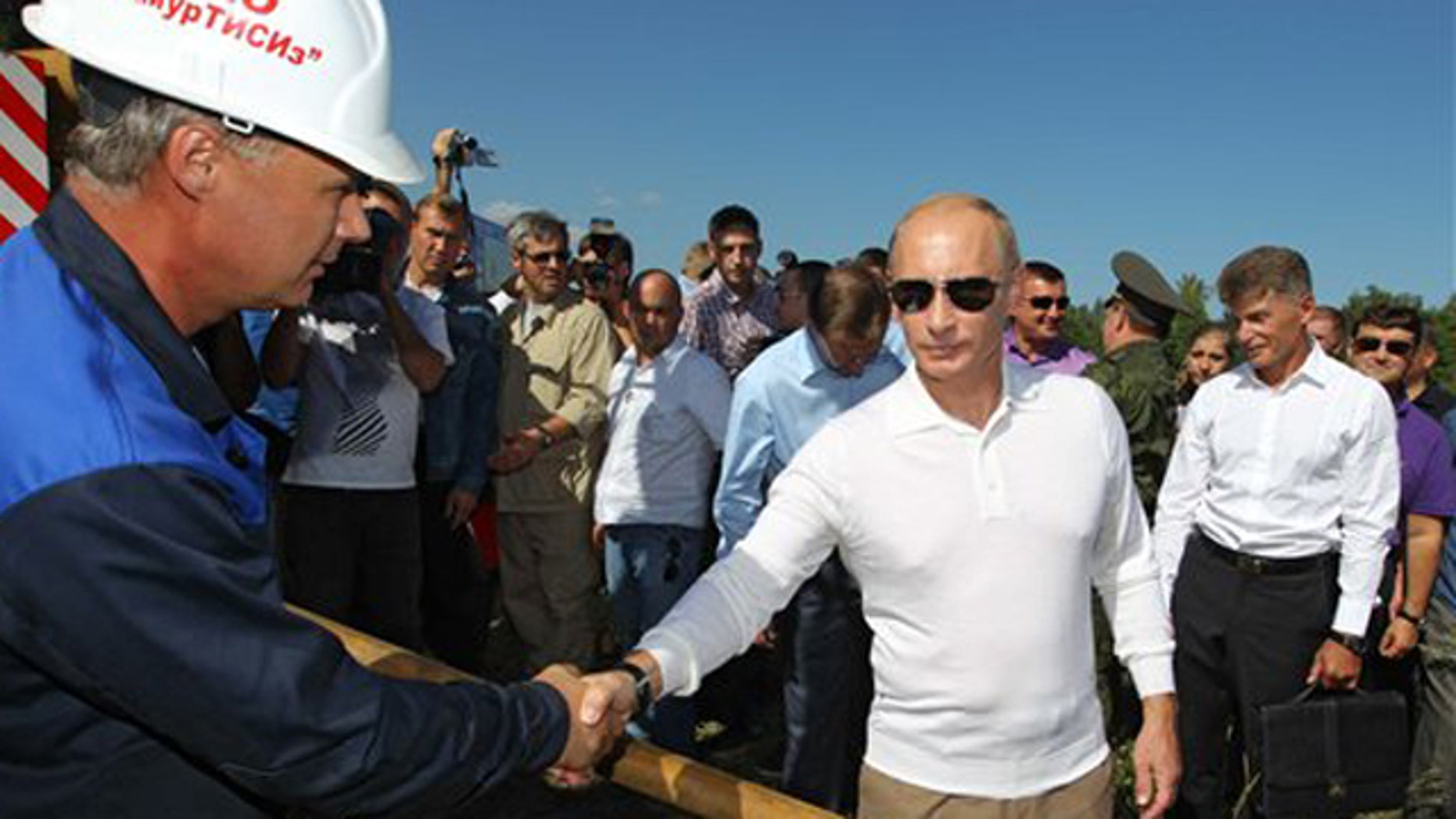 Aug. 28, 2010: Russian Prime Minister Vladimir Putin, right, shakes hands while visiting the construction site of a new launch facility, the Cosmodrome Vostochny, outside Uglegorsk, some 3,600 miles (5800 kilometers) east of Moscow, Russia, Saturday. Russia will launch its manned space missions from a new center in the Far East in 2018, Prime Minister Vladimir Putin said Saturday, as the country seeks greater independence for its space program.