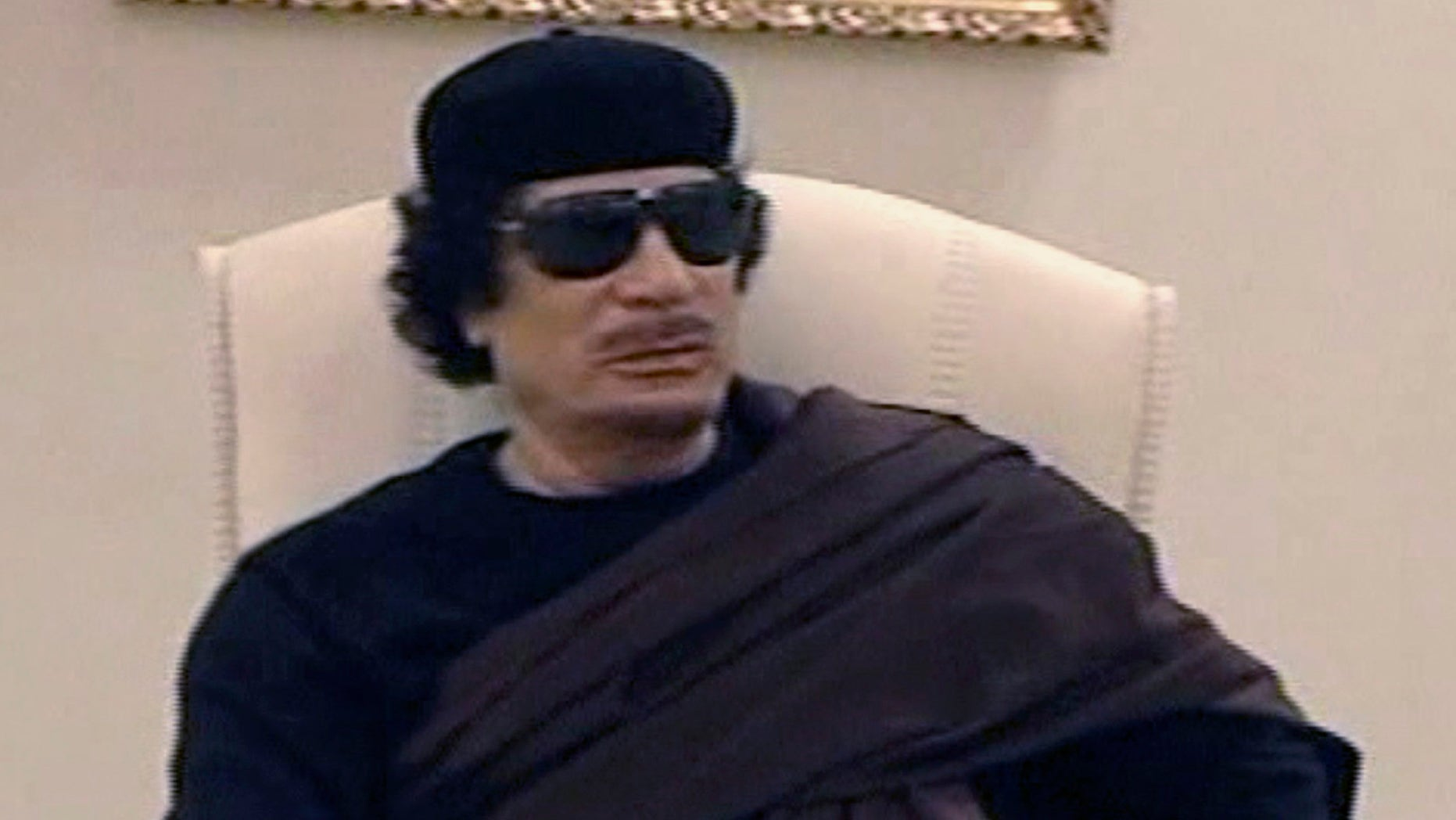 May 11: In this image made from Libyan TV, Libyan leader Muammar al-Qaddafi holds a meeting with tribal leaders from eastern Libya,  in Tripoli, Libya.