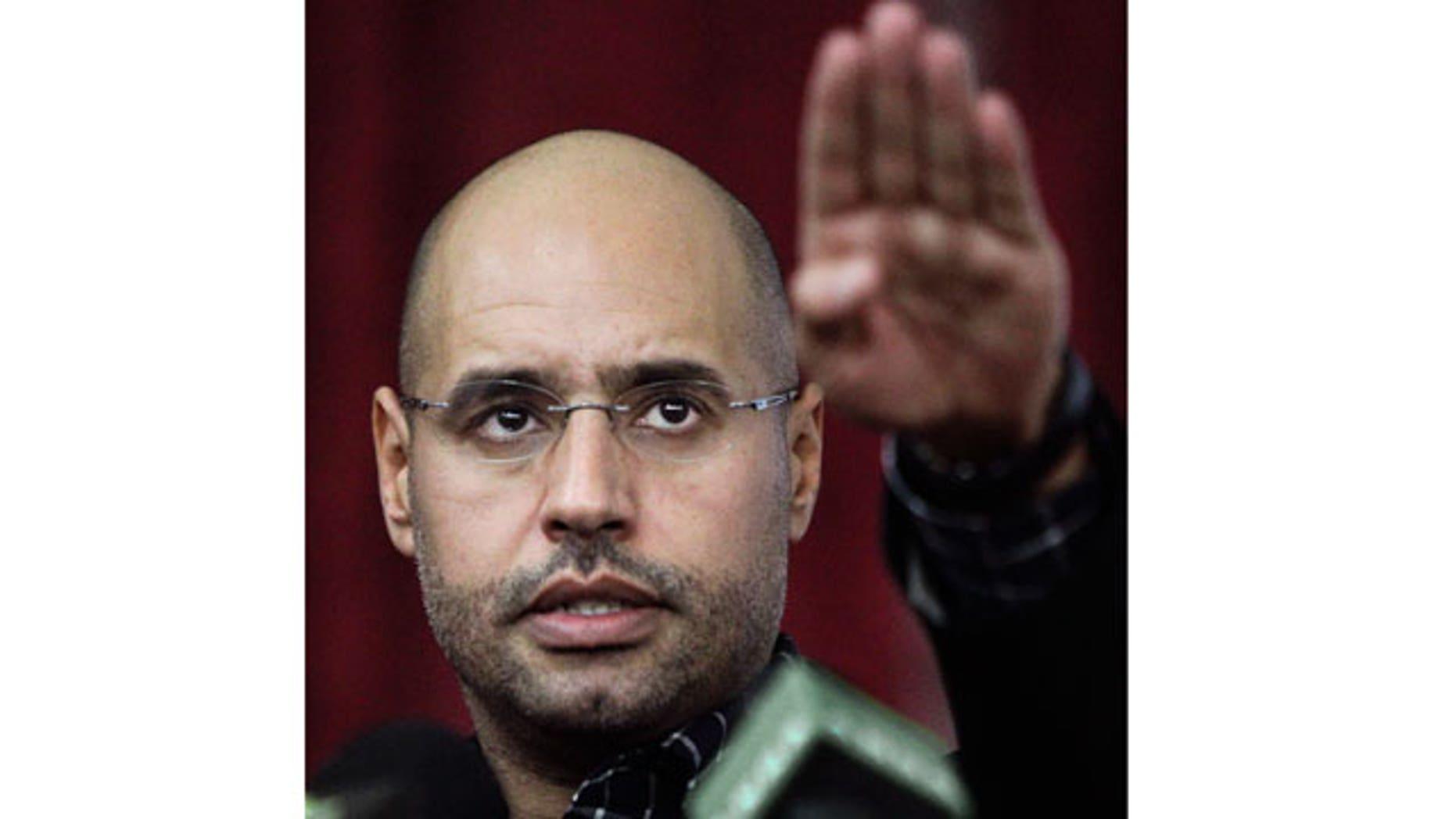 March 10, 2011: Seif al-Islam Qaddafi, son of Libyan leader Muammar Qaddafi, gestures as he speaks to supporters and the media in Tripoli, Libya.