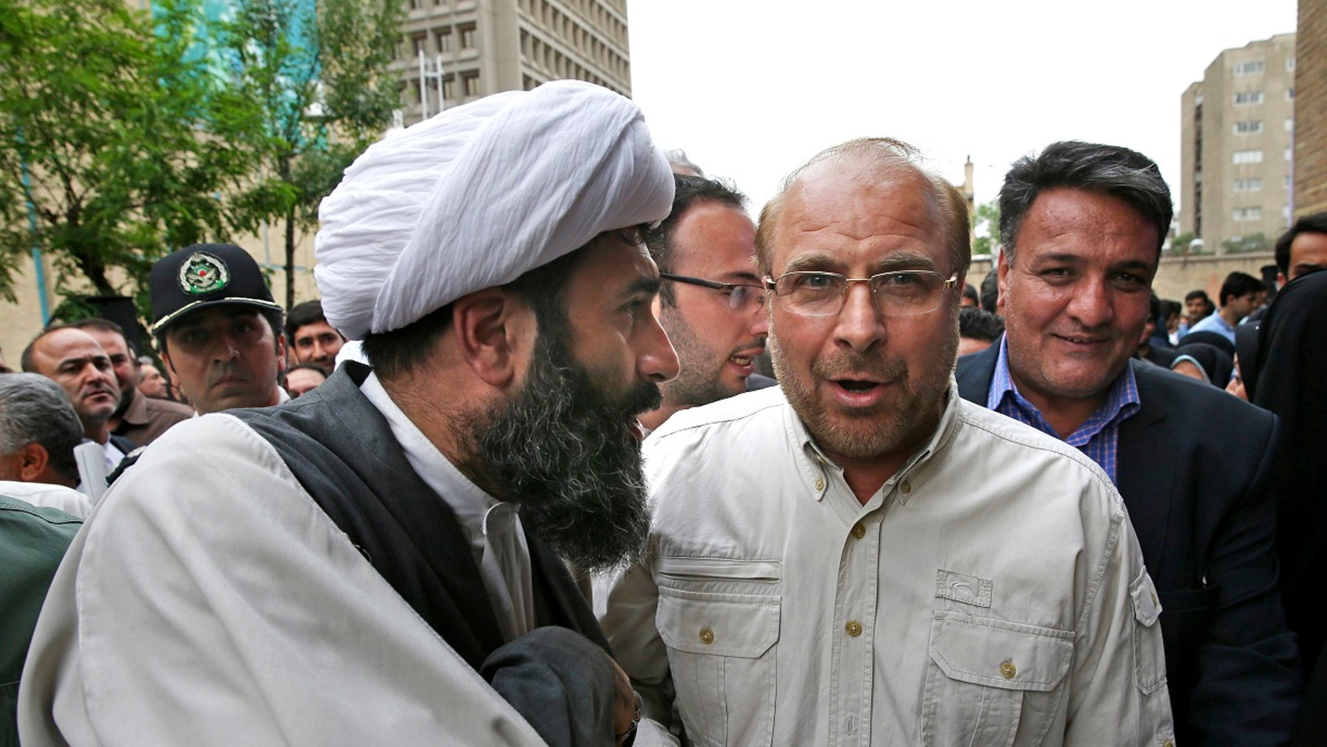 Tehran mayor Mohammad Bagher Qalibaf threw his support behind conservative Ebrahim Raisi for Iran's presidential election. The election is set to take place this Friday, May 19, 2017. Raisi is challenging Iranian President Hassan Rouhani.