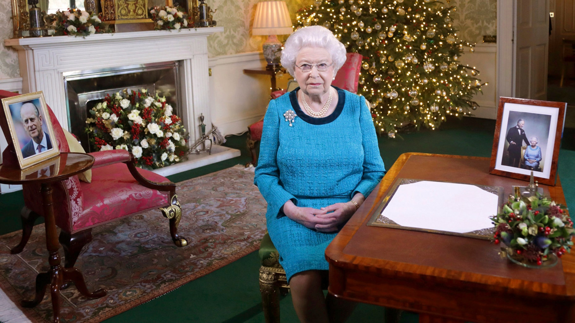 Dec. 25, 2016: Britain's Queen Elizabeth II poses for a photo while sitting at a desk in the Regency Room of Buckingham Palace in London, after recording her traditional Christmas Day broadcast to the Commonwealth.