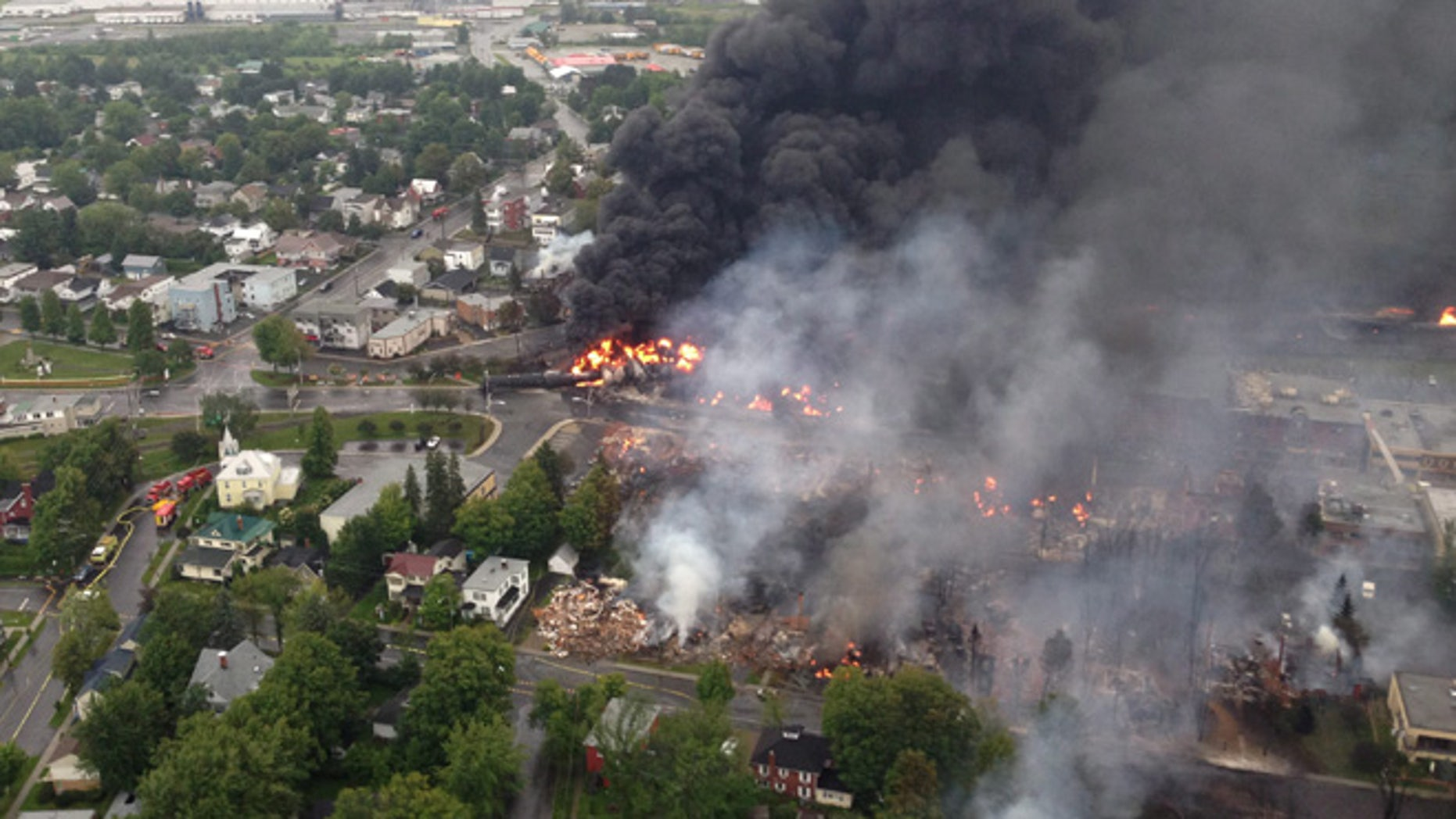 July 6, 2013: This aerial photo shows a fire in the town of Lac-Megantic as seen from a Sûreté du Québec helicopter following a train derailment that sparked several explosions in Lac Megantic, Quebec.