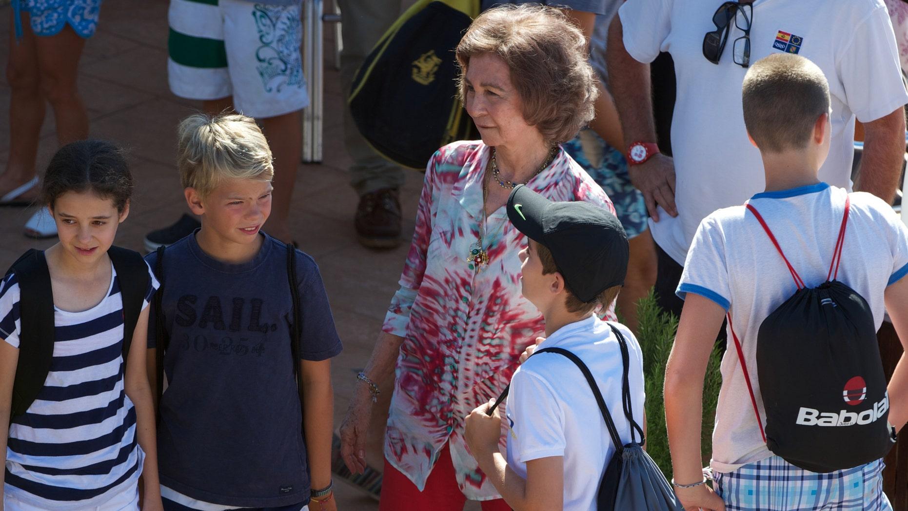 MALLORCA, SPAIN - JULY 29:  Queen Sofia of Spain (C) and her grandsons (L-R) Victoria Federica Marichalar, Pablo Nicolas Urdangarin, Miguel Urdangarin and Juan Valentin Urdangarin arrive at Calanova Sailing School on July 29, 2013 in Palma de Mallorca, Spain.  (Photo by Carlos Alvarez/Getty Images)