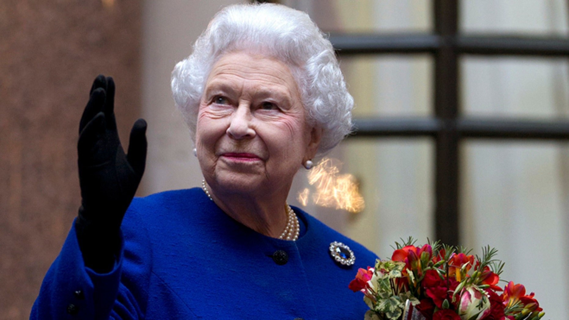 Dec. 18, 2012: In this file photo, Britain's Queen Elizabeth II looks up and waves to members of staff of The Foreign and Commonwealth Office as she ends an official visit which is part of her Jubilee celebrations in London. She has no formal political role, but Queen Elizabeth II has been named Britain's most powerful woman by a BBC radio program.