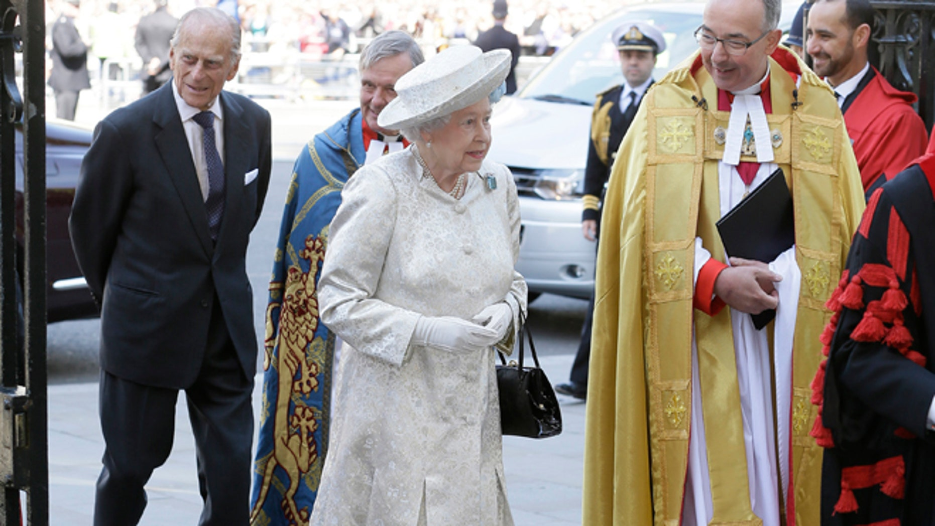 June  4, 2013: Britain's Queen Elizabeth II and her husband Prince Philip, left, arrive for service to celebrate the Queen's 60th anniversary of her coronation at Westminster Abbey, escorted by The Dean of  the Abbey  Dr John Hall in London.