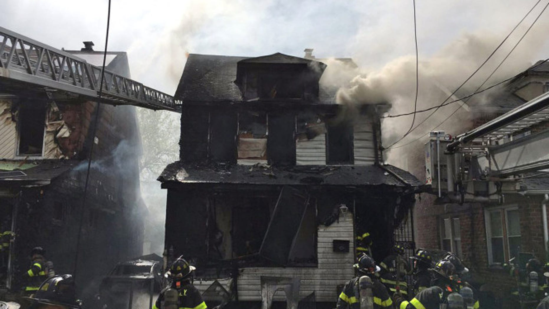 Five people died in a Queens house fire on Sunday.