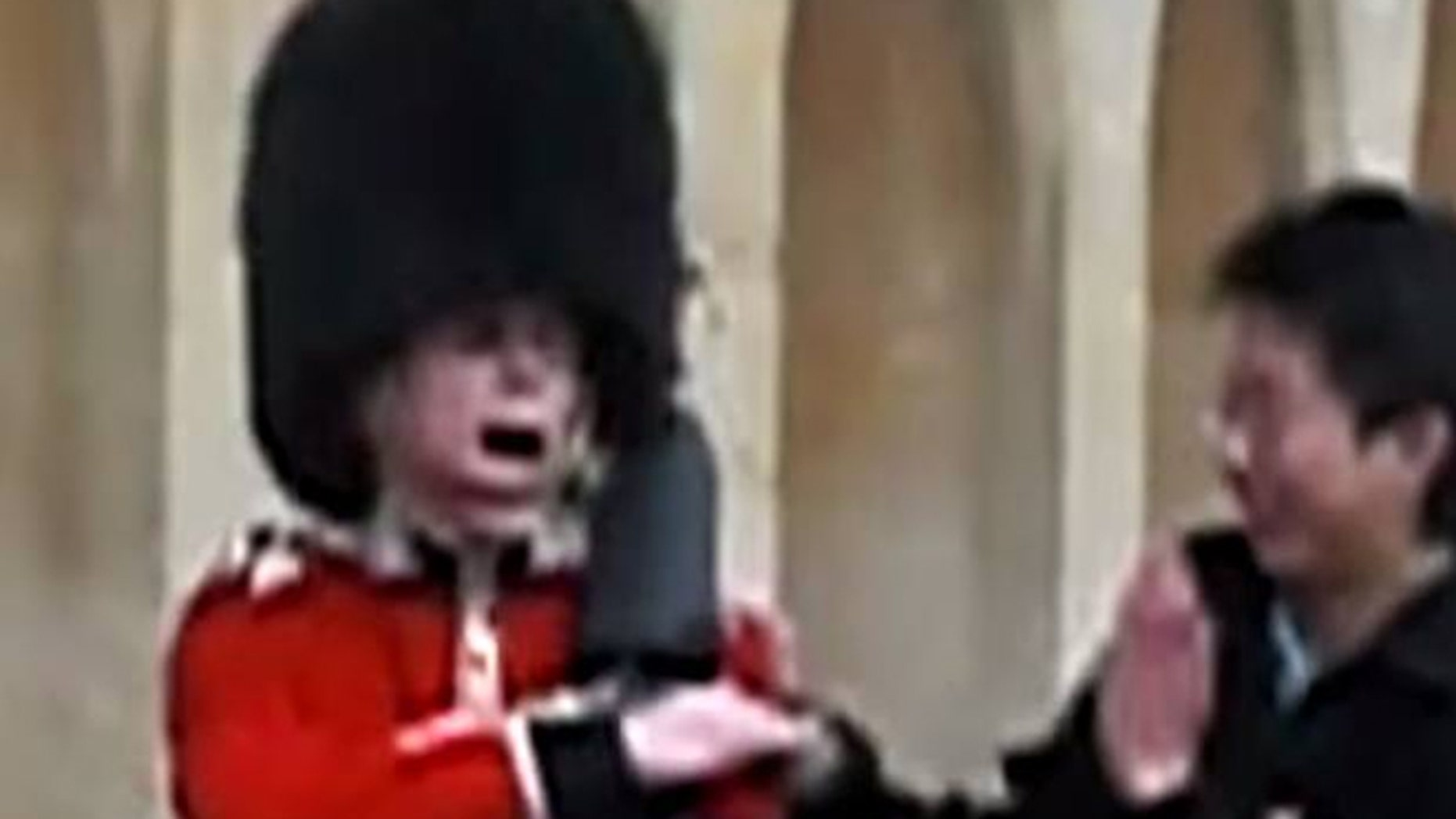 The moment a Queen's Guard pulls rifle on a tourist who touched him.