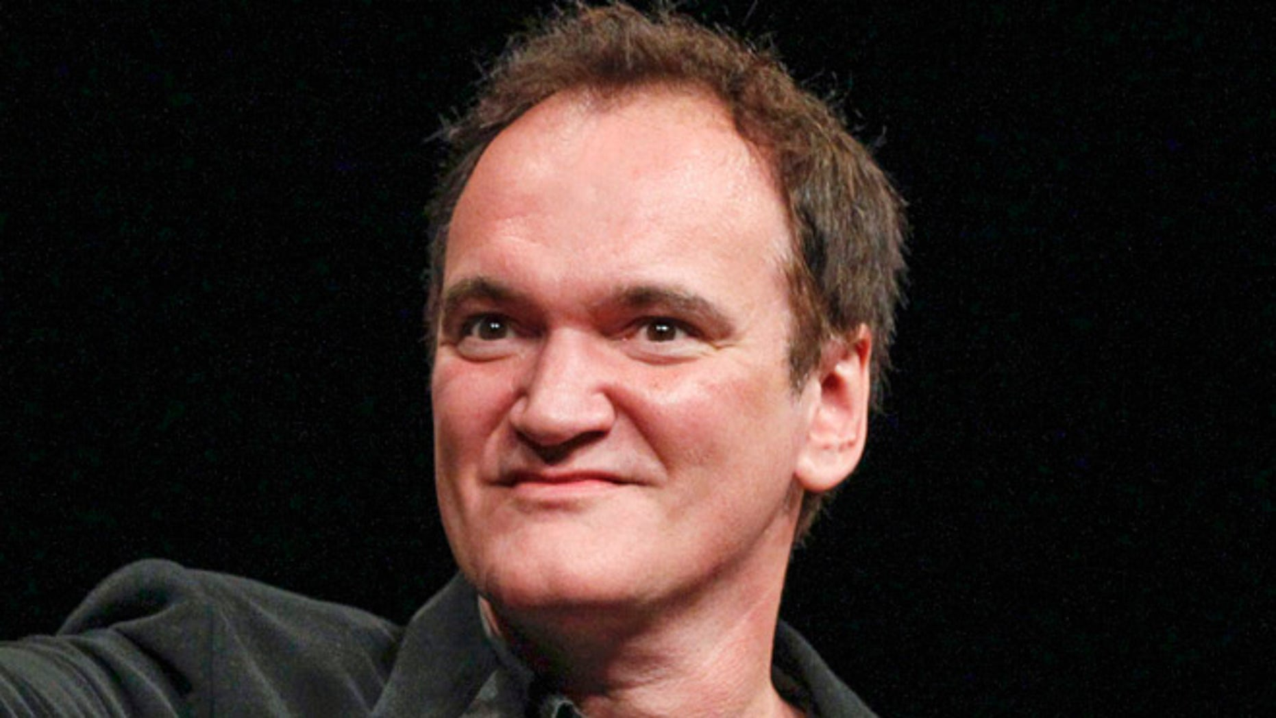 U.S. director Quentin Tarantino gestures after receiving the Prix Lumiere award during a ceremony at the 5th Festival Lumiere in Lyon, October 18, 2013.  REUTERS/Robert Pratta(FRANCE - Tags: ENTERTAINMENT PROFILE) - RTX14GB8