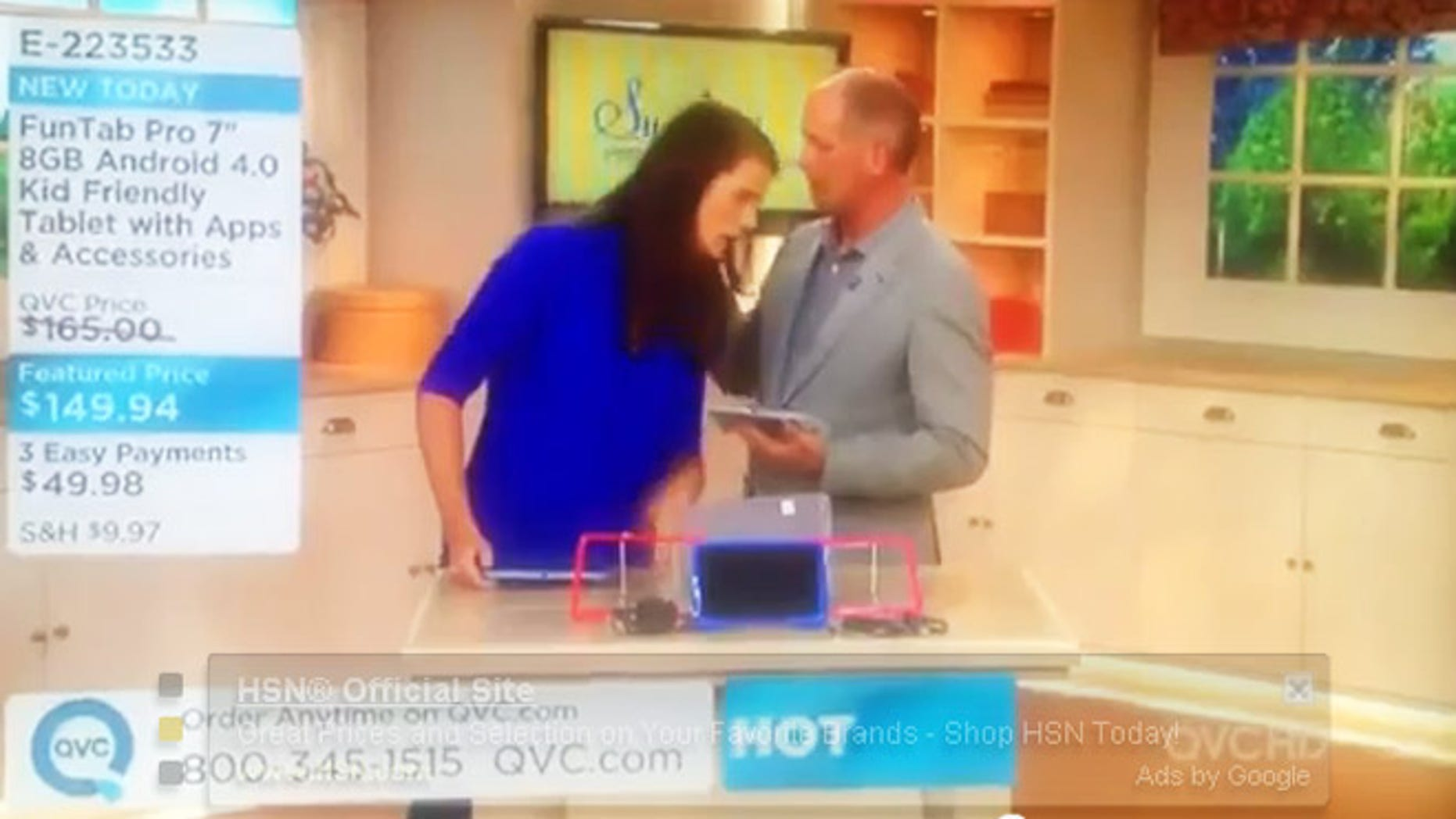 QVC host clutches chest and falls into co-host on air