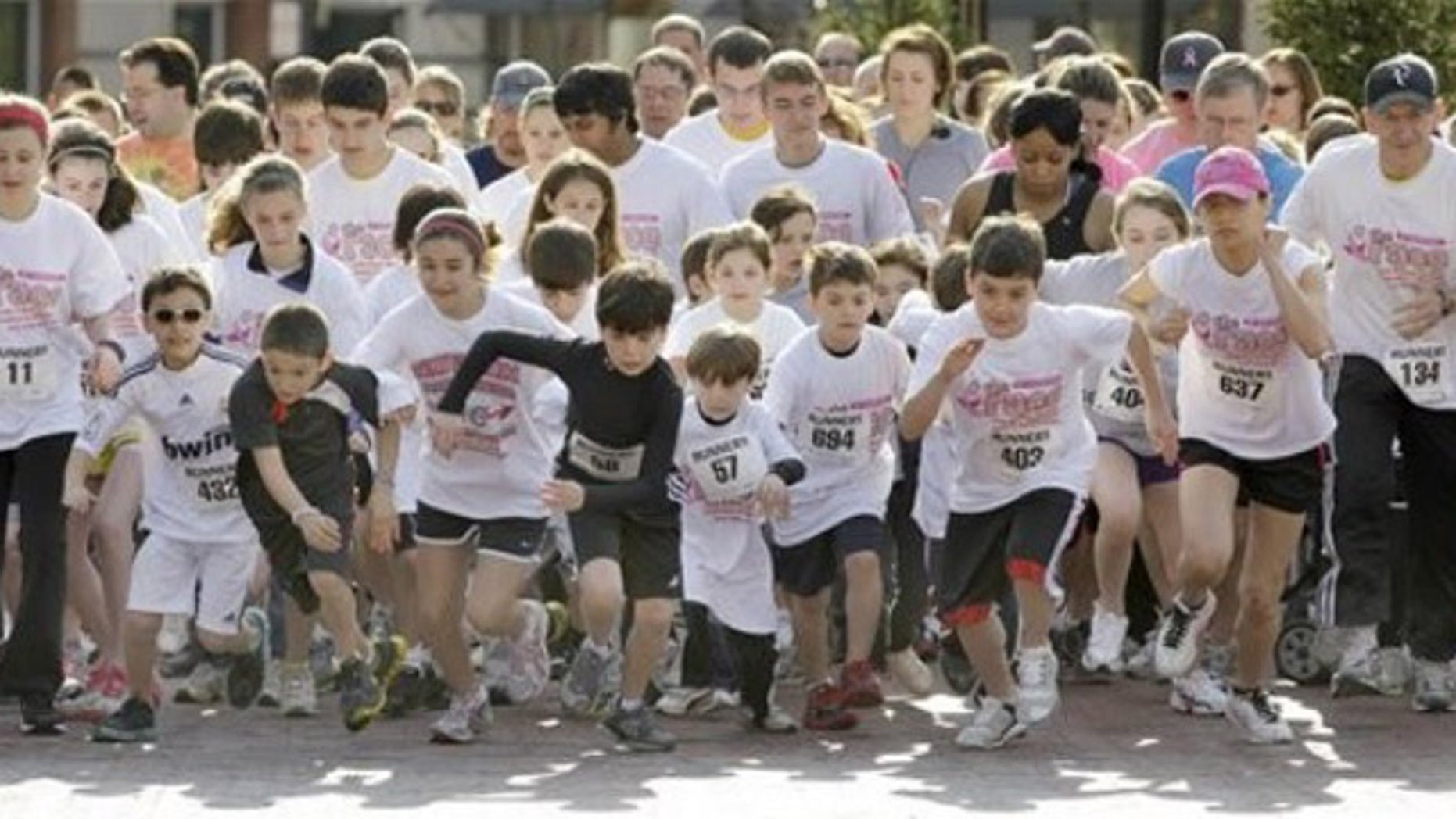 Shown here is the start of a race to benefit Susan G. Komen for the Cure and another cancer-fighting group in Lyndhurst, Ohio, on May 8.