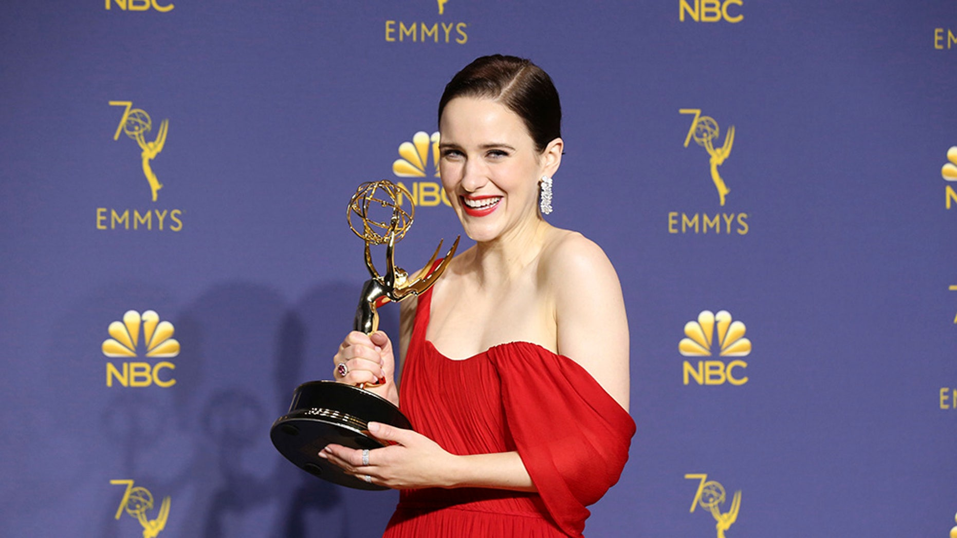 """Rachel Brosnahan poses in the press room with the award for outstanding lead actress in a comedy series for """"The Marvelous Mrs. Maisel."""""""