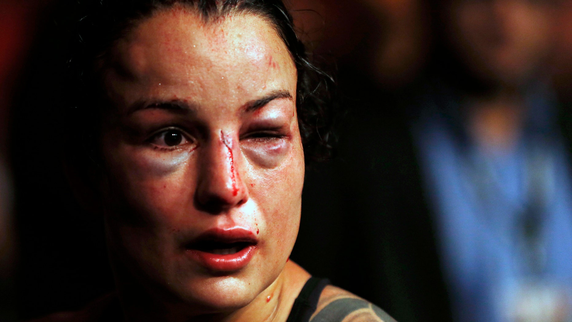 Raquel Pennington was beaten bloody by Amanda Nunes in their bantamweight title fight Saturday in Rio de Janeiro.