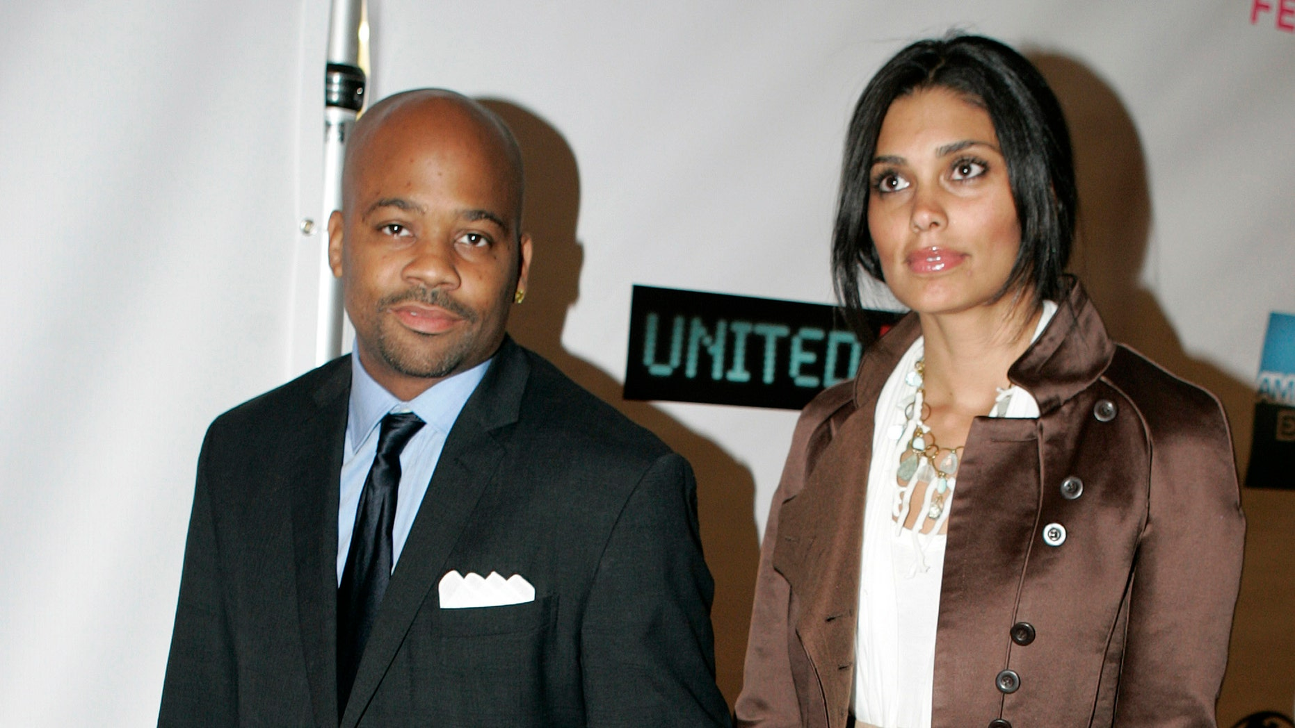 April 25, 2006. Music producer Damon Dash and his wife Rachel Roy (R) at The Tribeca Film Festival in New York.