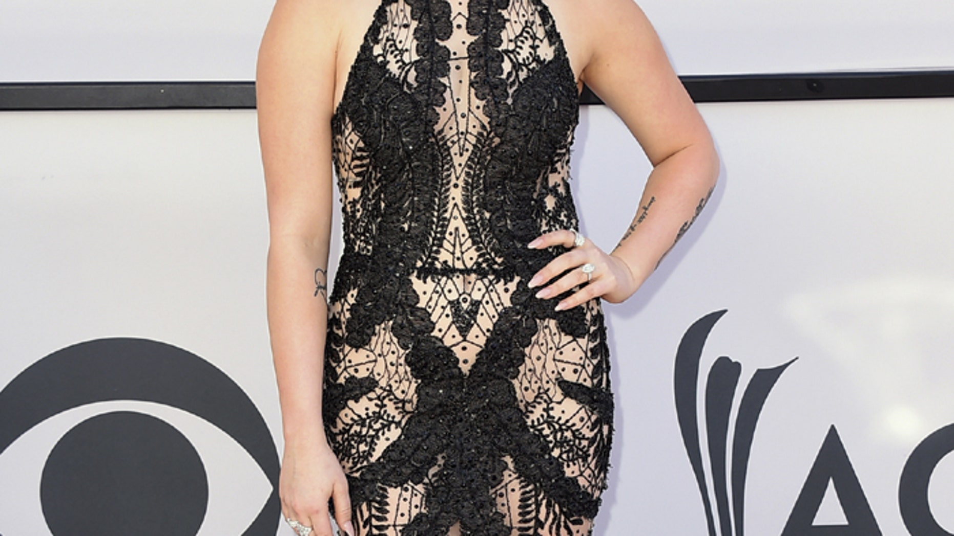 RaeLynn arrives at the 52nd annual Academy of Country Music Awards at the T-Mobile Arena on Sunday, April 2, 2017, in Las Vegas. (Photo by Jordan Strauss/Invision/AP)